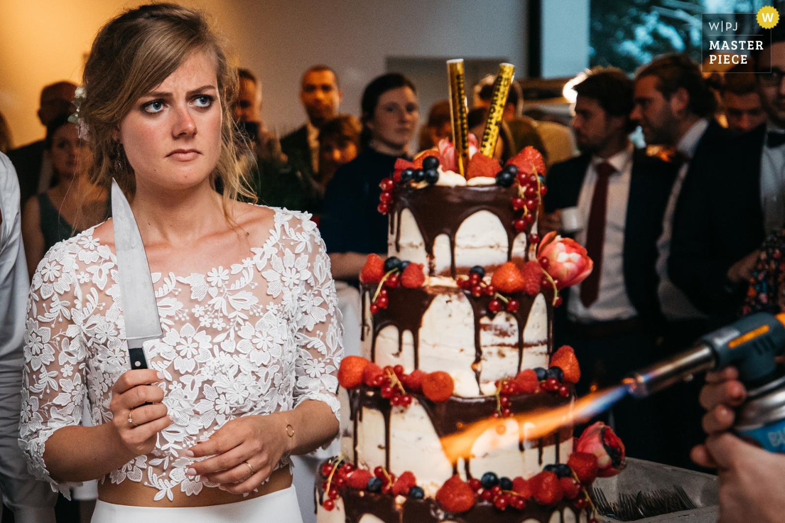 the bride is contemplating the cake cutting right after it was taken in to the venue - Antwerpen, Flanders Wedding Photography -  | Reception venue