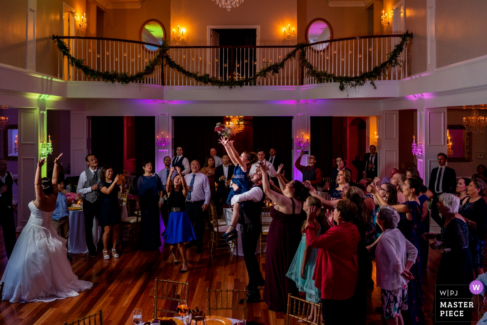 The flower girl is lifted into the air as the bride throws the bouquet. Wedding photography by Bee Two Sweet. - Arlington, Virginia Wedding Photography -    Rose Hill Manor, Raspberry Plain, Leesburg VA