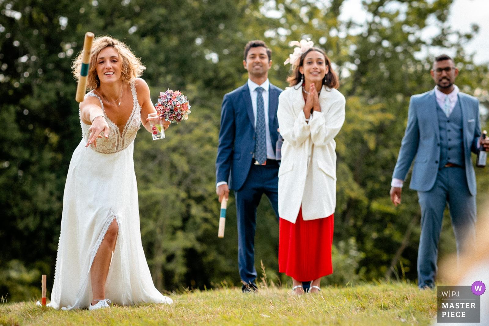 Bride playing garden games - Hertfordshire, England Wedding Photography -    Swallows Oast, UK