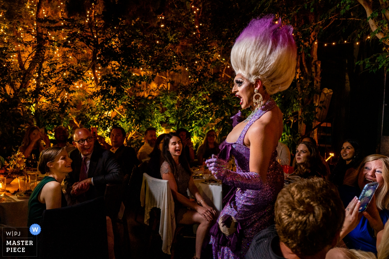 """Wedding photo by Bee Two Sweet Photography, drag queen Leilani Lopez entertains everyone during dinner with a lip sync of """"Poor Unfortunate Souls"""" by Ursula - Arlington, Virginia Wedding Photography -    Michael's Restaurant, Santa Monica CA"""