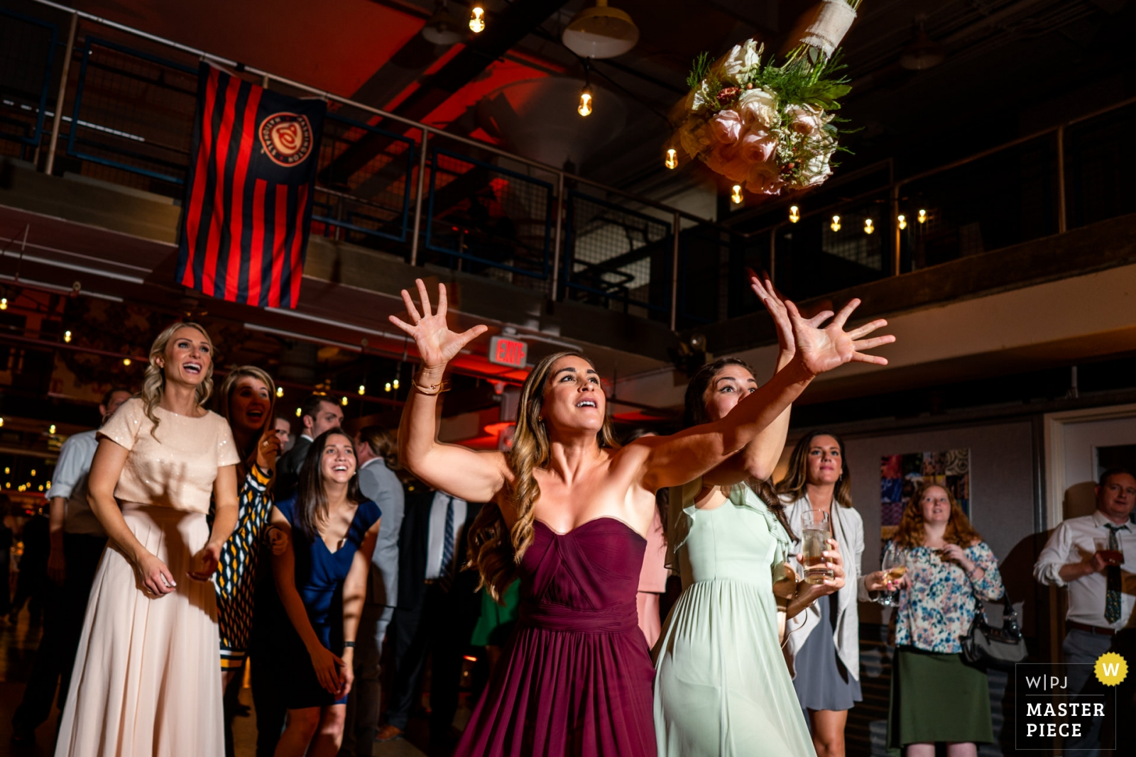 Wedding photo by Bee Two Sweet Photography, bridesmaid almost catches the bouquet - Arlington, Virginia Wedding Photography -  | Torpedo Factory, Old Town Alexandria VA