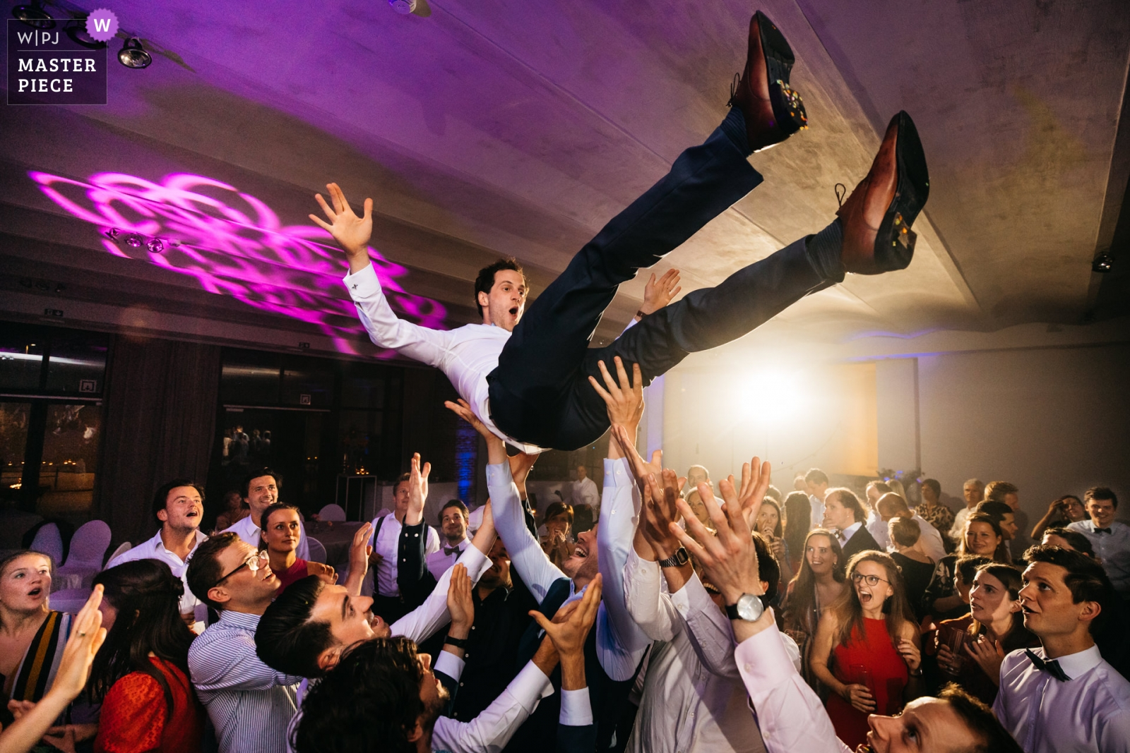 Groom is tossed up in the air during the party - Antwerpen, Flanders Wedding Photography -  | reception venue