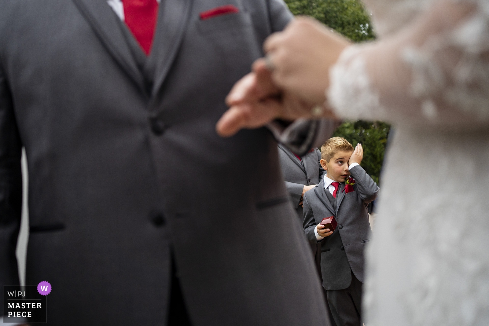 Ring bearer wipes away tears while the ring is put on - Atlanta, Georgia Wedding Photography -  | Hazlehurst House Mcdonough Georgia