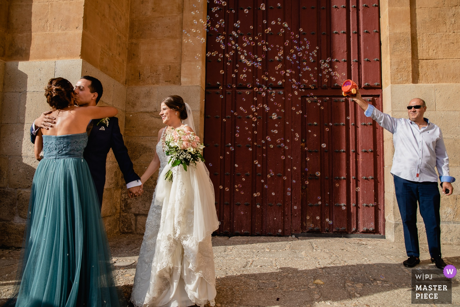Bubble throwing after ceremony - Madrid, Spain Wedding Photography -  | Catedral de Salamanca
