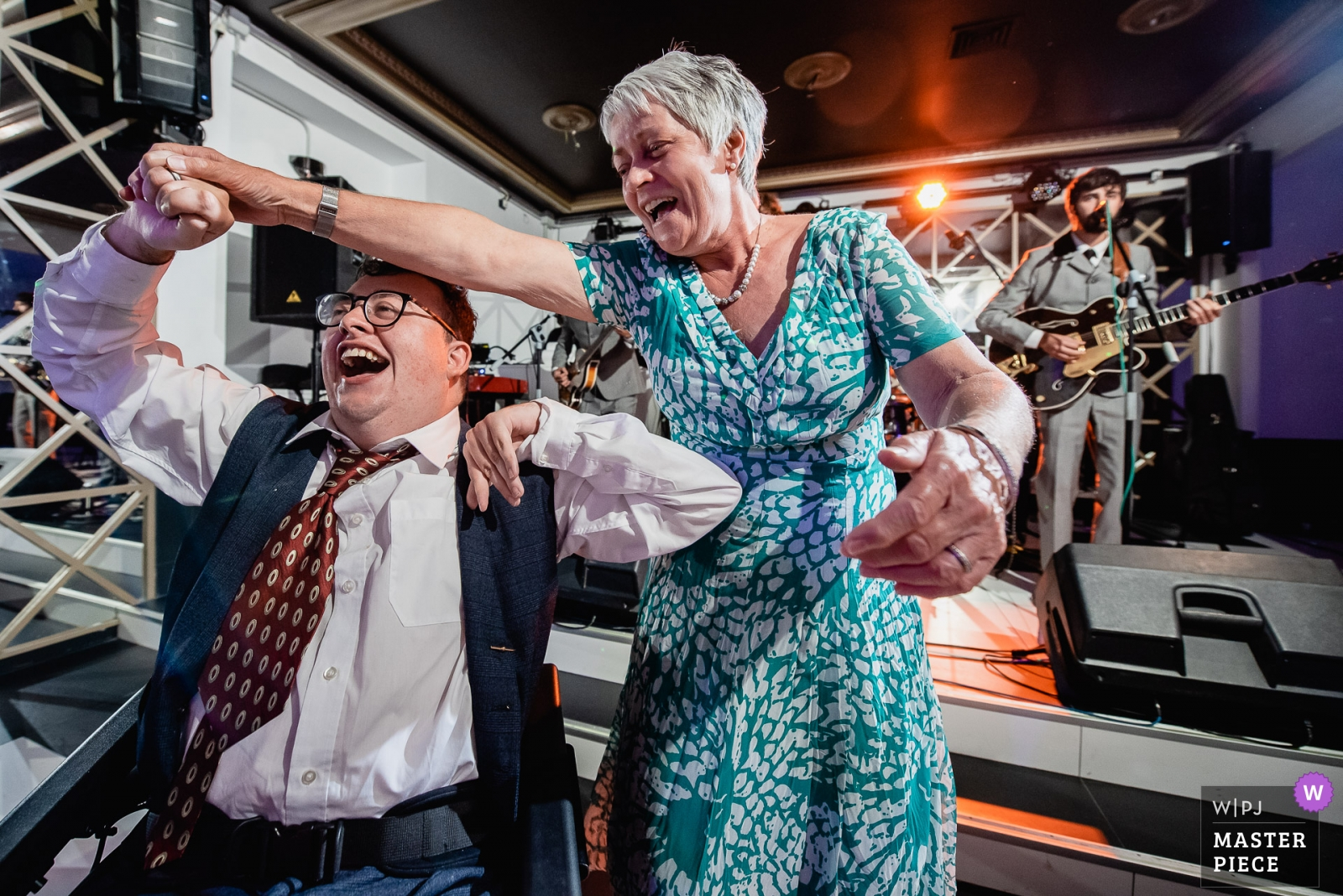 Bride's brother, with cerebral palsy, enjoys the band during the party - Madrid, Spain Wedding Photography -  | Palacio de Silvela