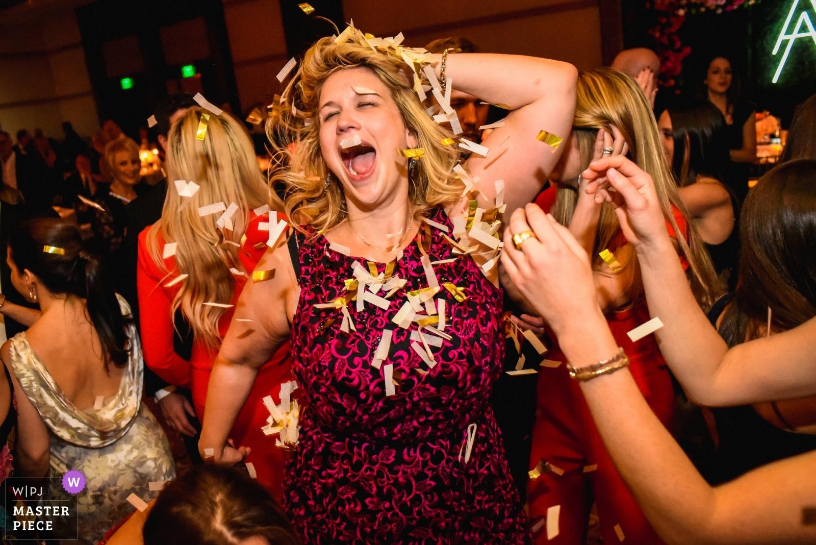 A wedding guests dances on the dance floor - San Diego, California - Southern Wedding Photography -  | The ritz, dove mtn, tucson, AZ