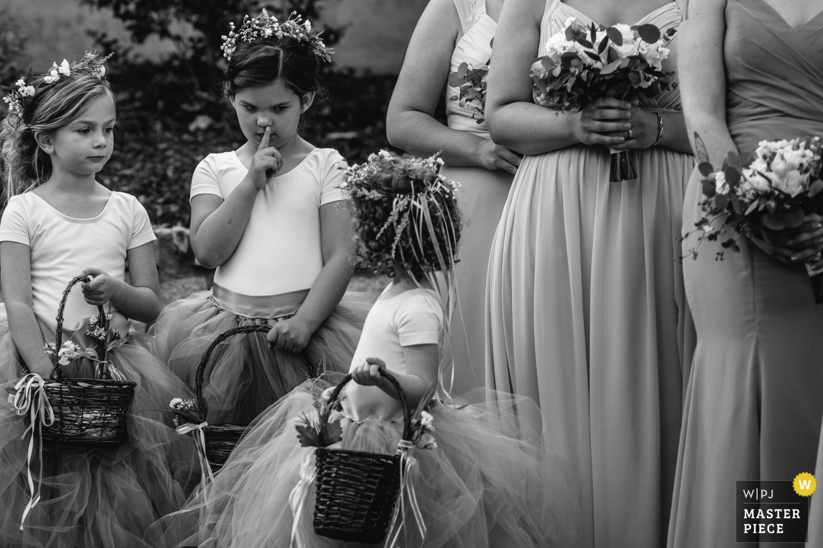 One flower girl shushes another during the ceremony. - Lake Tahoe, California - Northern Wedding Photography -    Haue Valley: Pacific, Missouri