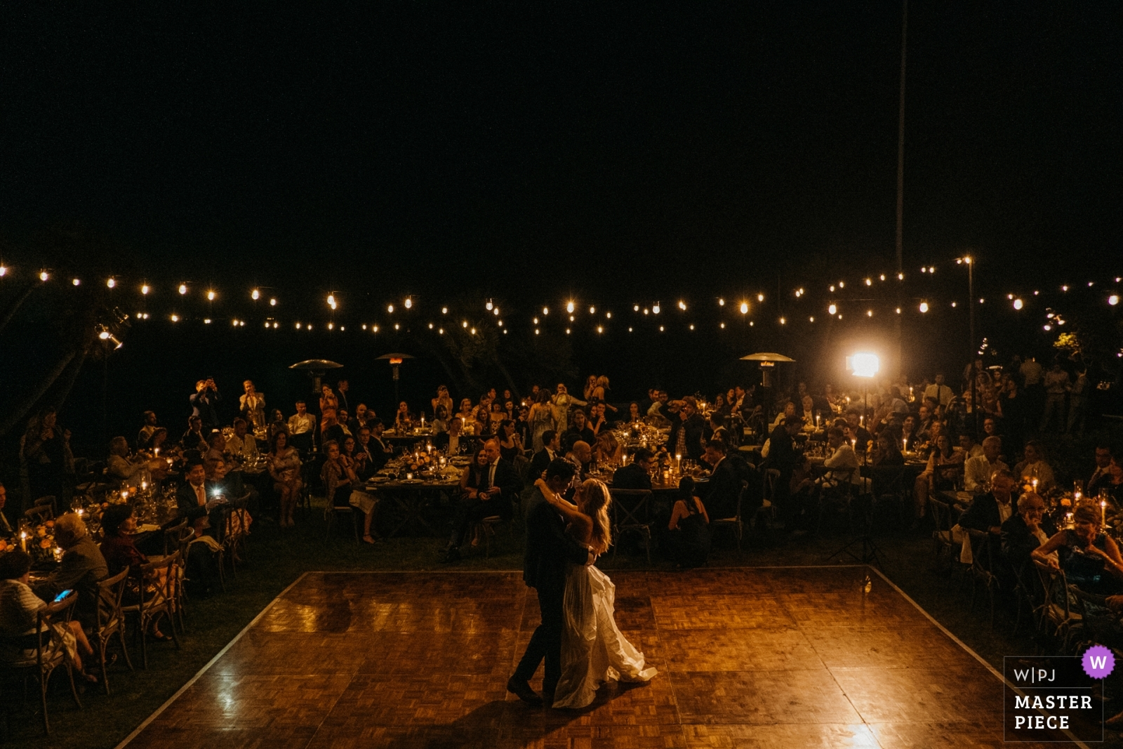 The bride and groom dance for the first time as a married couple in front of their guests. - Los Angeles, California - Southern Wedding Photography -  | Adamson House, Malibu, California