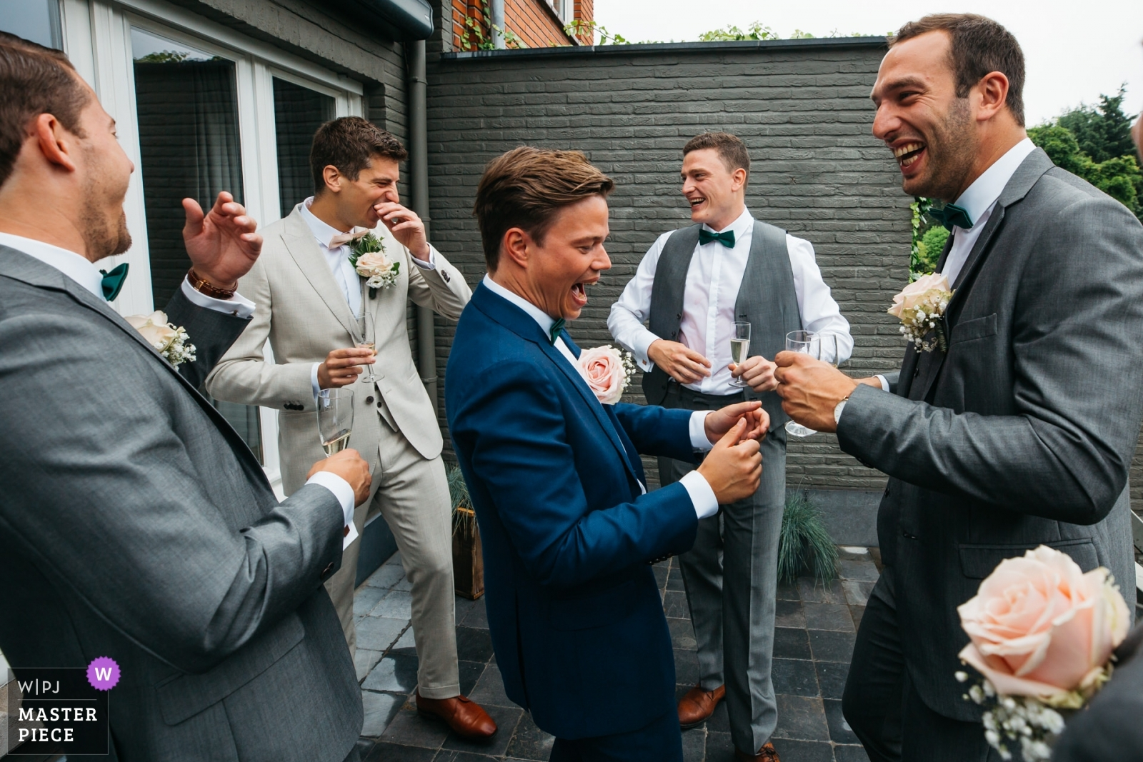 groomsmen are laughing with the sweatiness of one's groomsmen's shirt, early in the morning - Antwerpen, Flanders Wedding Photography -  | bride and groom's house