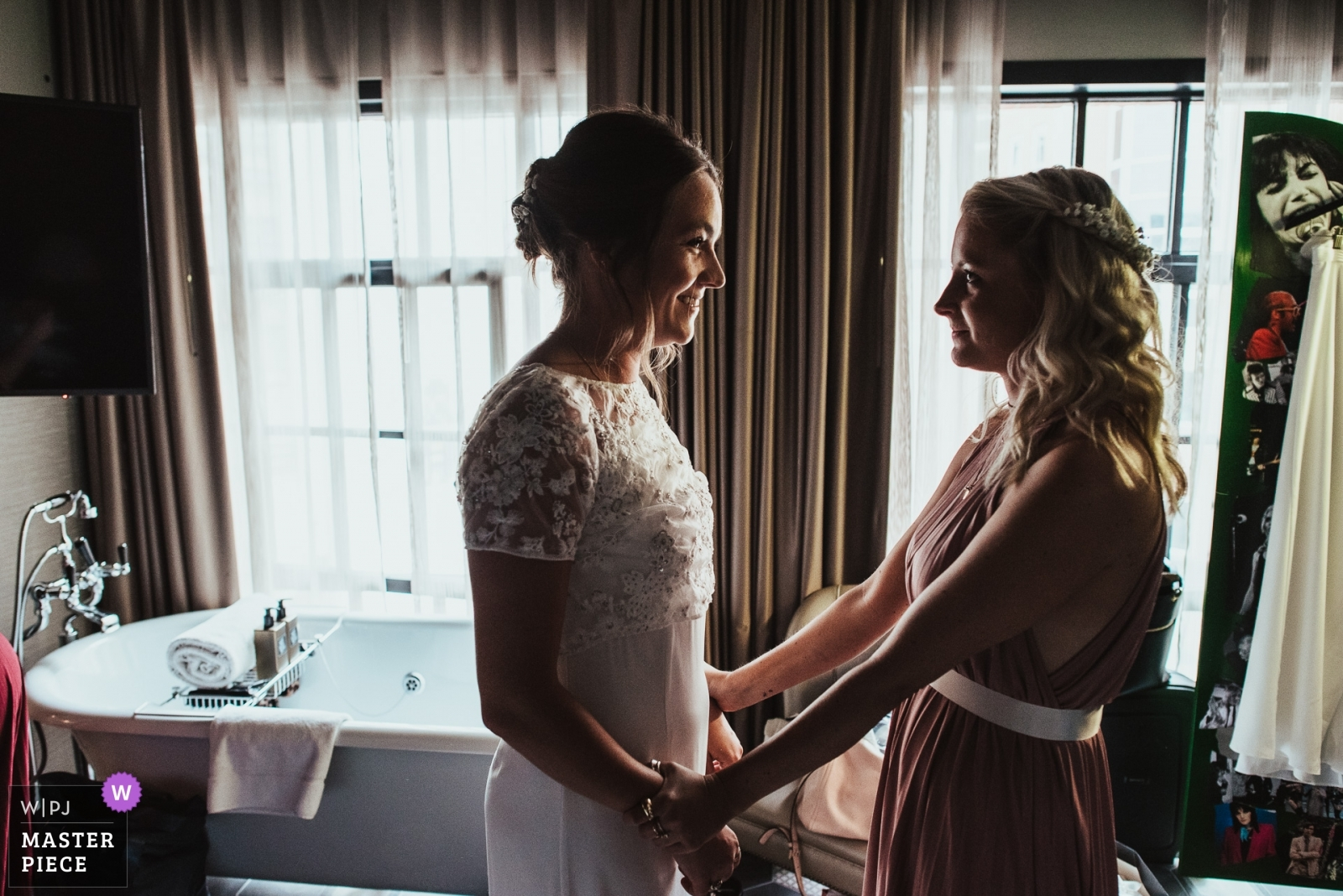 A bride is reassured by her bridesmaid before her wedding ceremony - Derbyshire, East Midlands Wedding Photography -  | The Curtain Hotel, Hackney, London