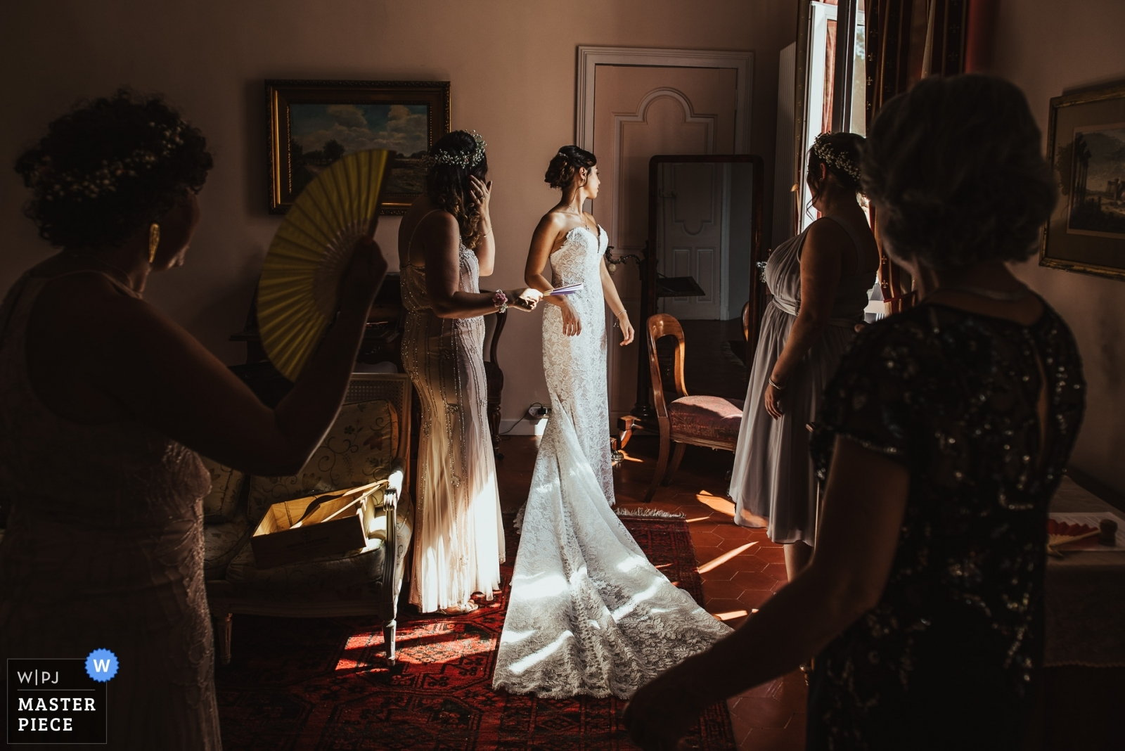 A bride is surrounded by her bridesmaids before her wedding ceremony - Derbyshire, East Midlands Wedding Photography -  | Château de Roquelune, Pezenas, France