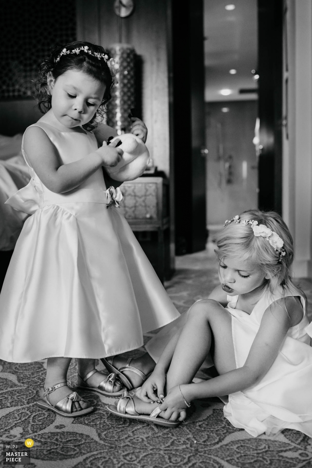 Chatty Flowergirls getting dressed  - Dubai UAE, United Arab Emirates Wedding Photography -  | The Ritz Dubai