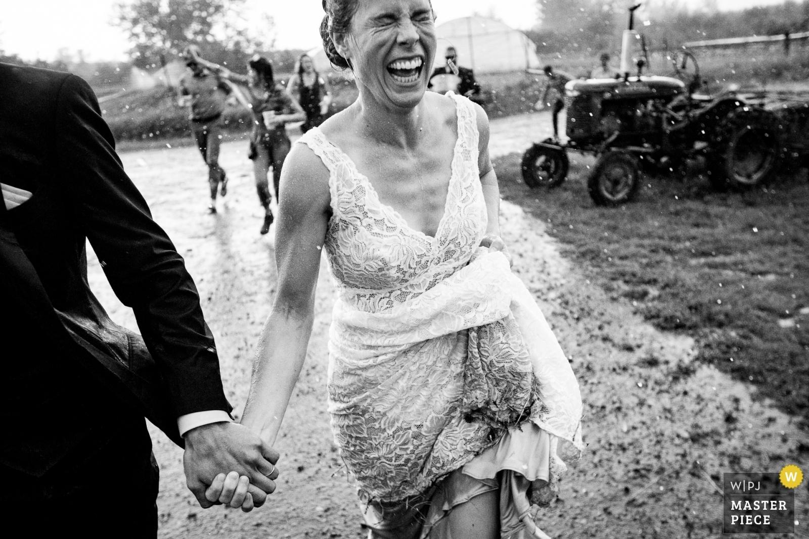 bride running in rain - Missoula, Montana Wedding Photography -  | Bozeman, Montana