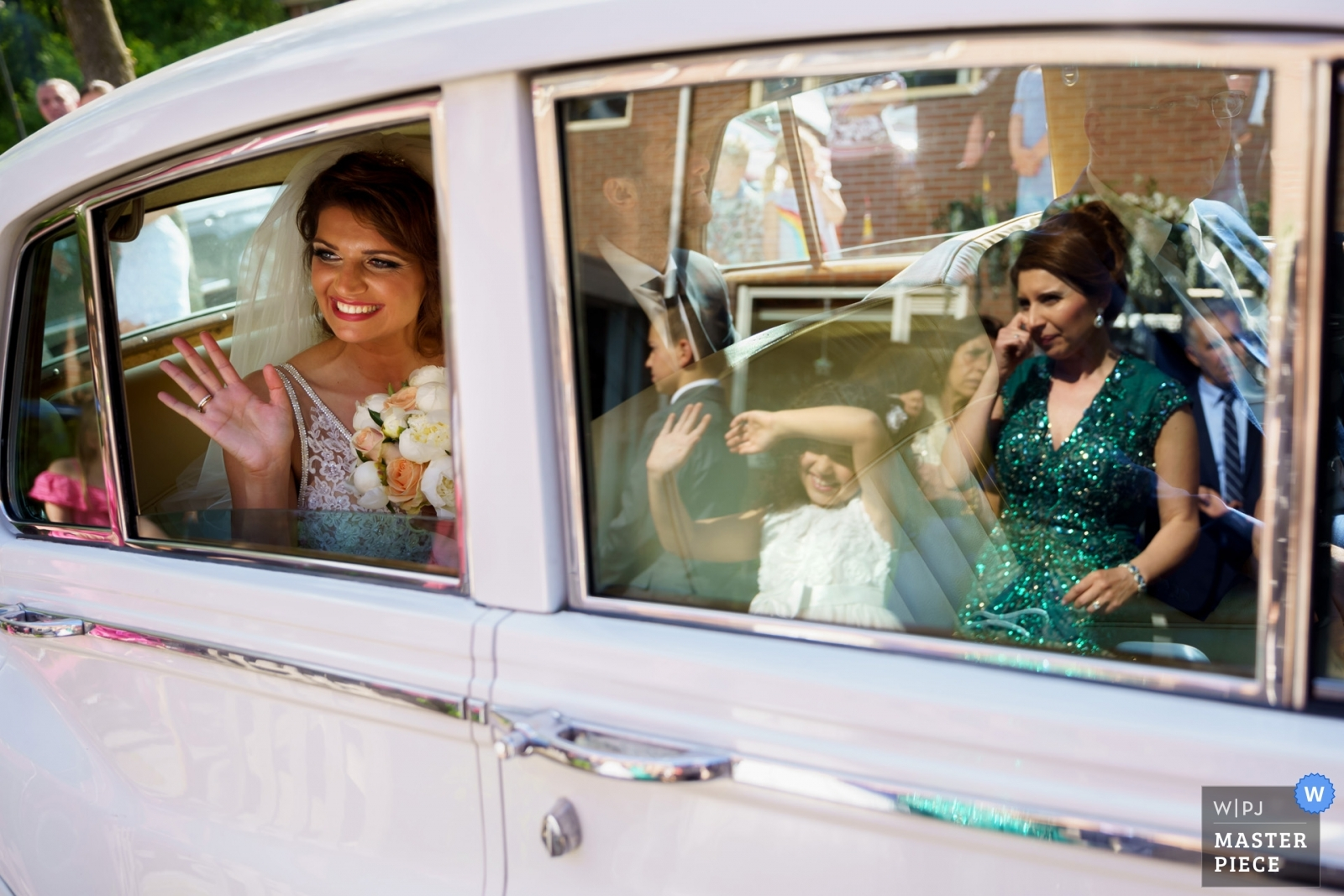 Waving from the car - Overijssel, Netherlands Wedding Photography -    Enschede