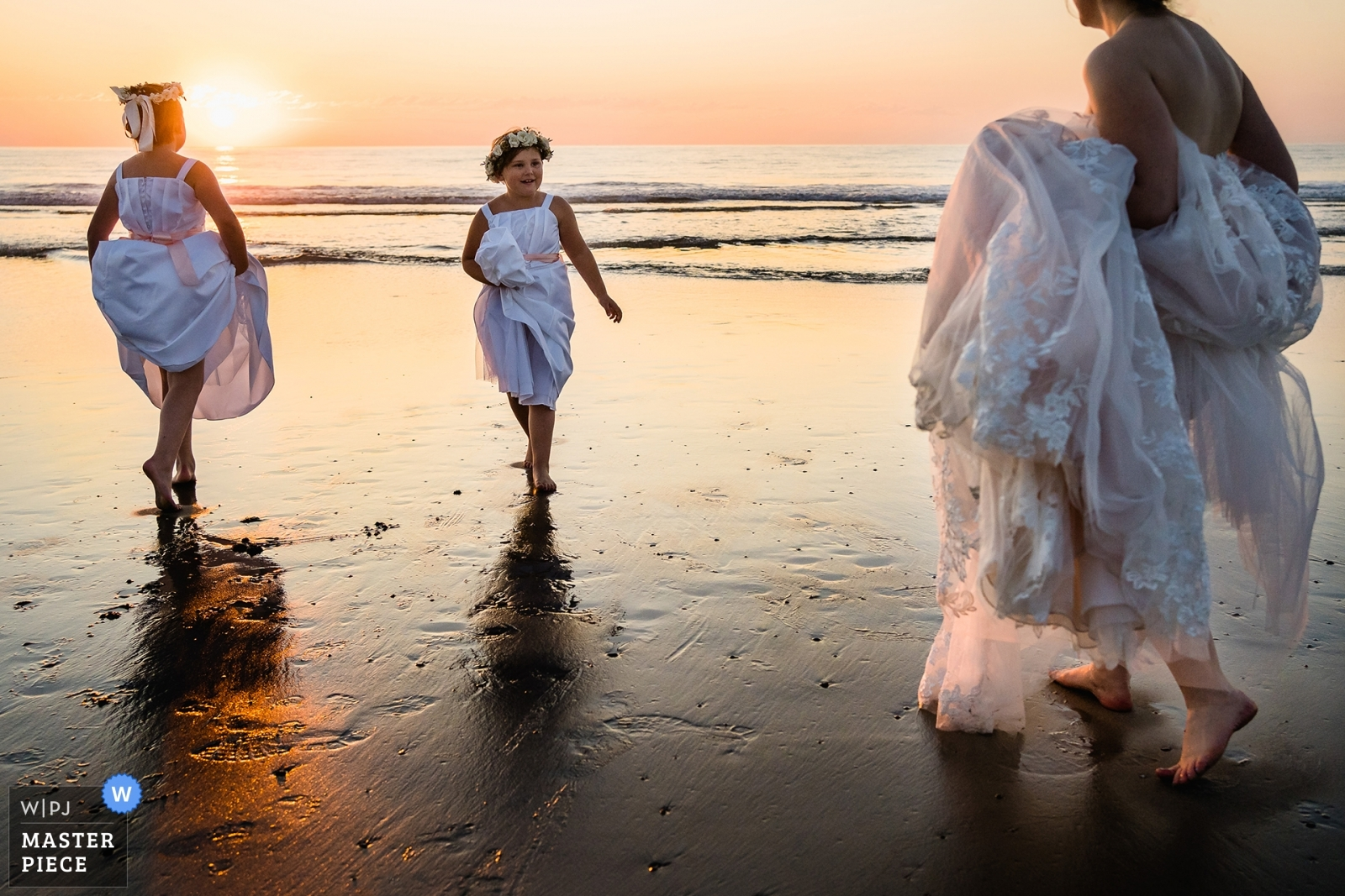 Flower girls and bride are enjoying sunset on the beach before the reception - San Diego, California - Southern Wedding Photography -  | Del Mar, Ca