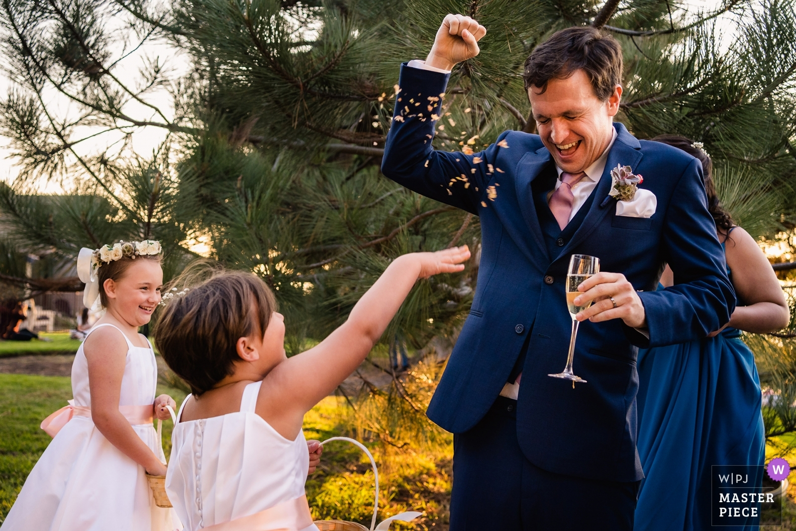 flower girls throw their remaining flowers at the groom - San Diego, California - Southern Wedding Photography -  | Del Mar, Ca