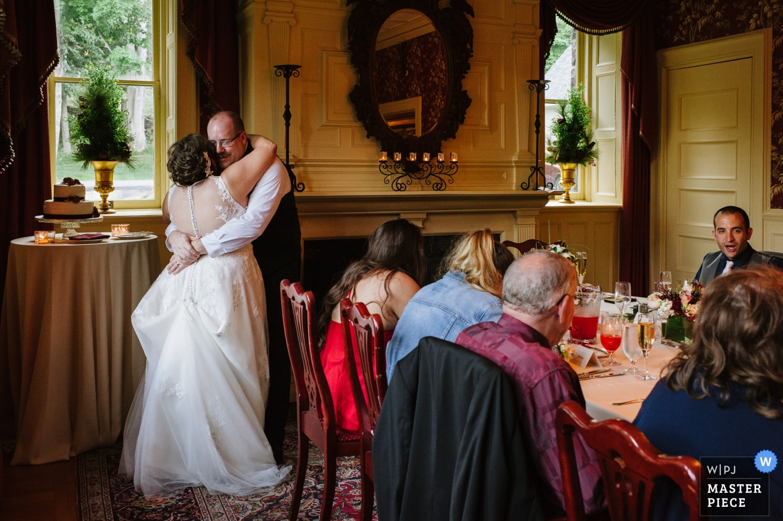 A bride and groom dance together closely during dinner at their wedding. - Schenectady, New York - Upstate Wedding Photography -  | The Inn at Erlowest, Lake George, NY