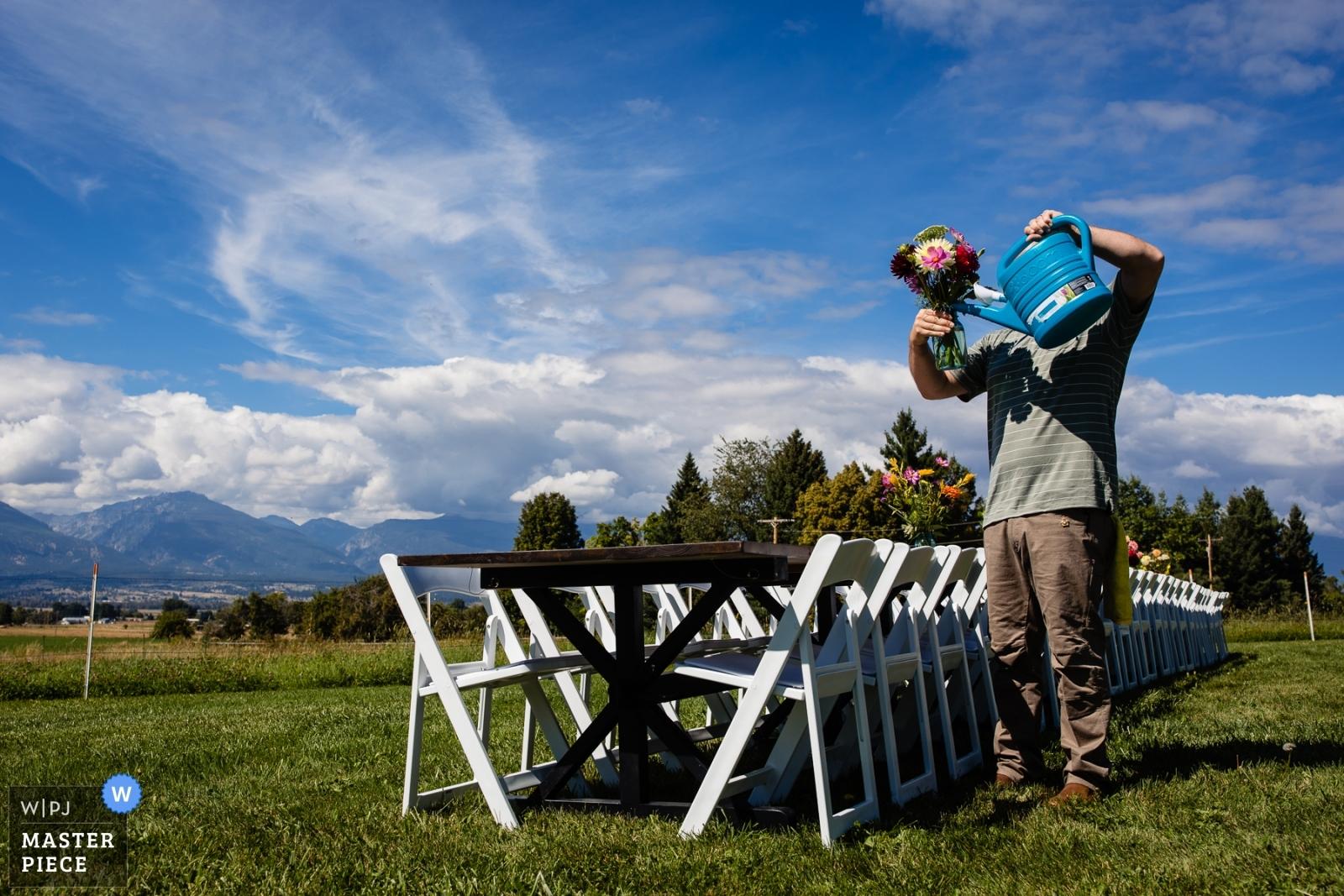 groom watering flowers - Missoula, Montana Wedding Photography -  | Corvallis, Montana