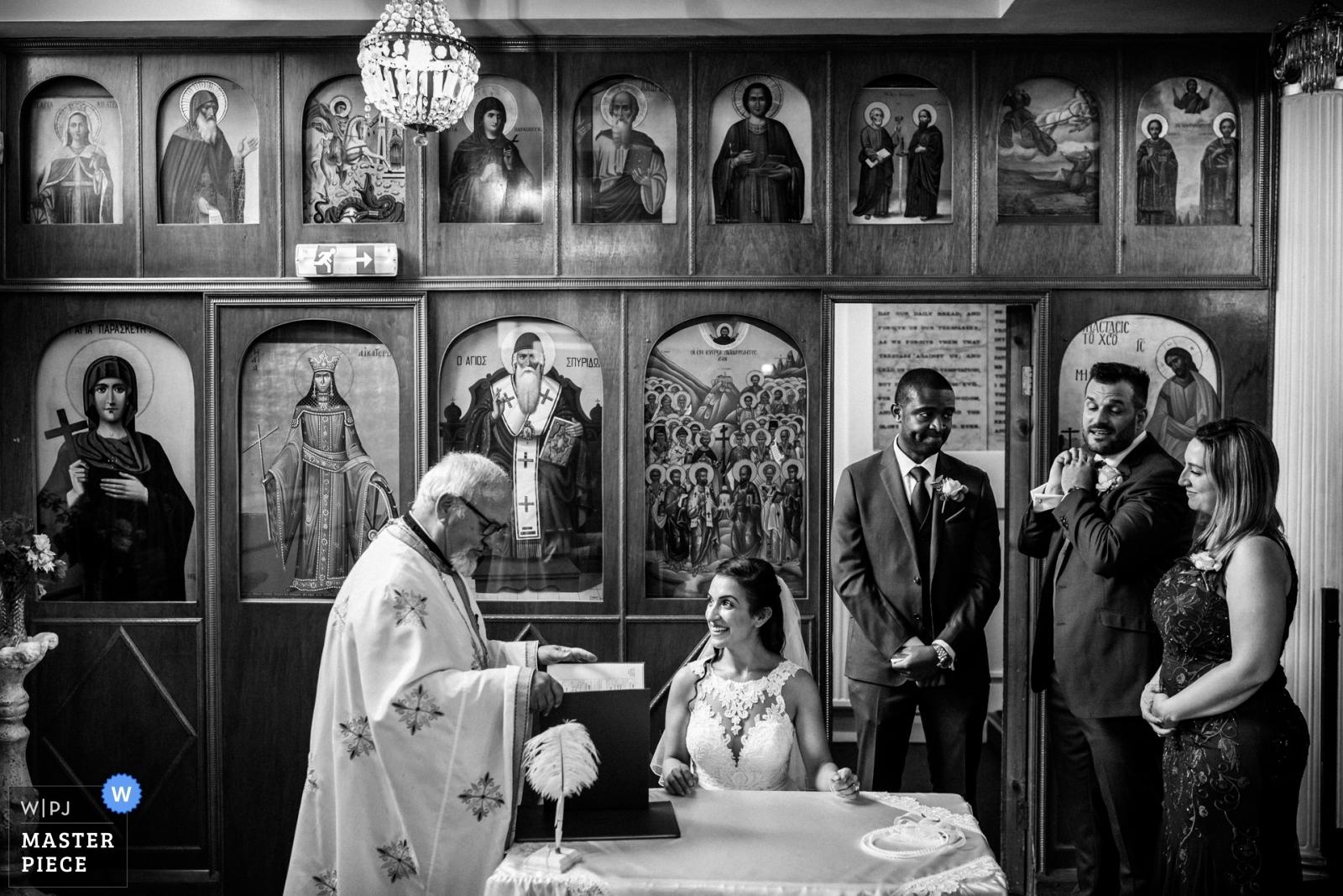 Signing the register - Hertfordshire, England Wedding Photography -  | Camden, London, UK