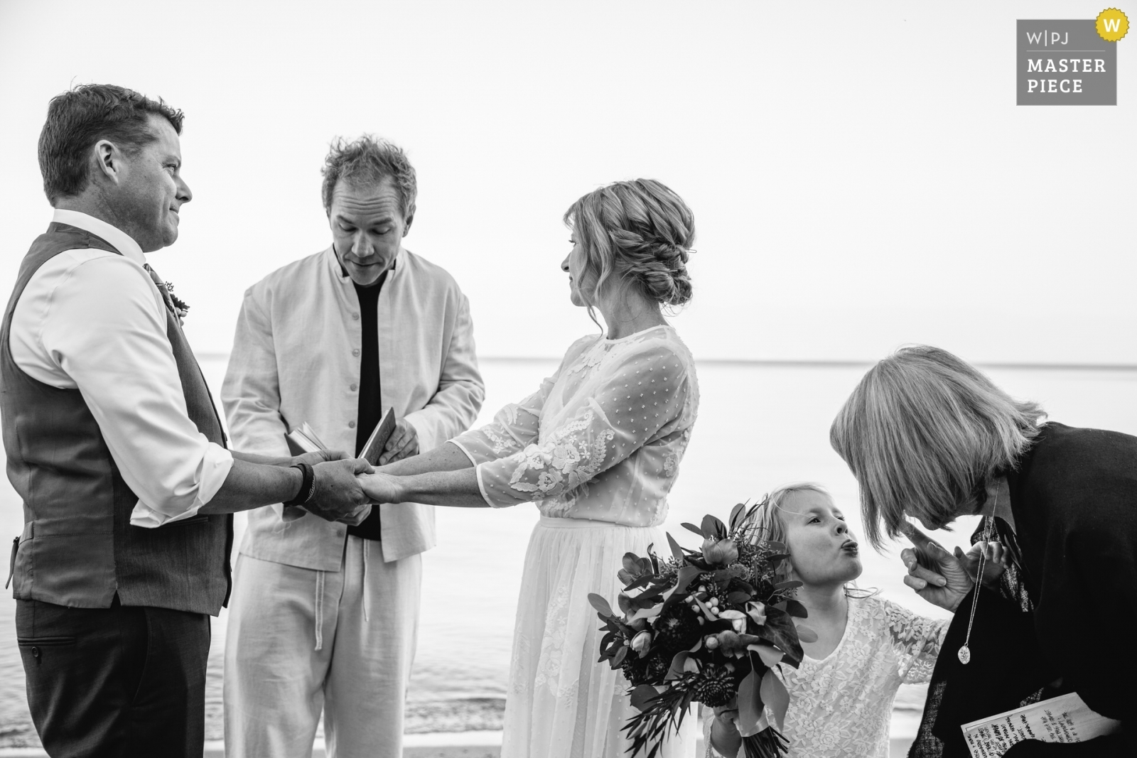 The bride's daughter goofs off during her mother's ceremony. - Lake Tahoe, California - Northern Wedding Photography -    Sugar Pine Point State Park: Tahoma, CA