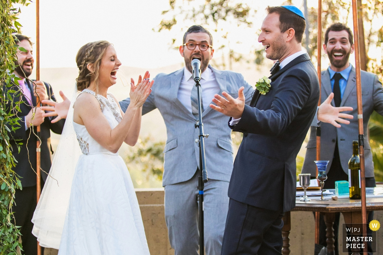 The newly-married couple celebrates with their rabbi and relatives under the jewish chuppah. - Los Angeles, California - Southern Wedding Photography -  | The Brandeis-Bardin Campus of American Jewish University, Brandeis, California