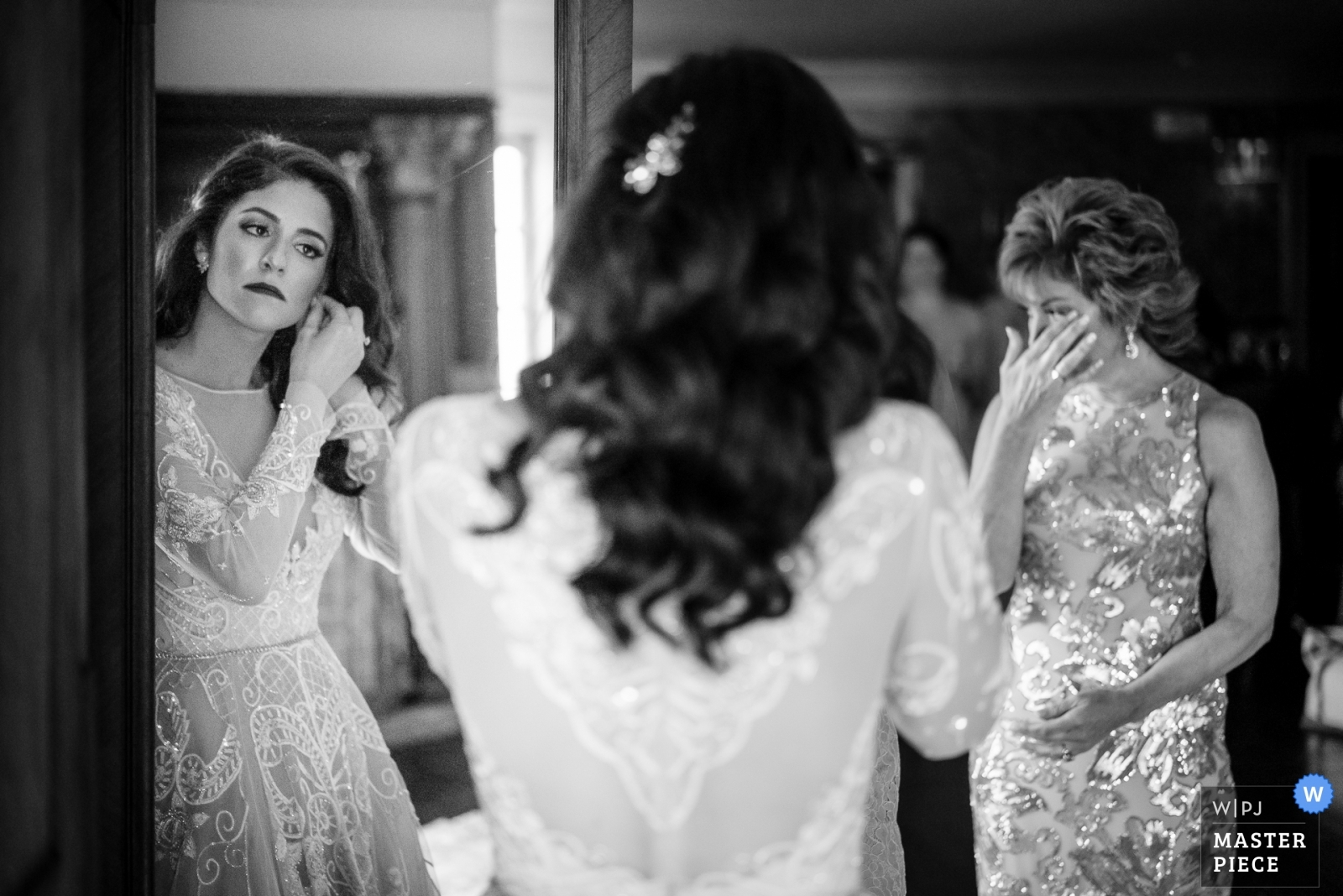 Bride putting the finishing touches on as she is about to hear out to the ceremony.  Meanwhile her mom looks on and gets emotional. - New Jersey, United States Wedding Photography -  | Reception Venue
