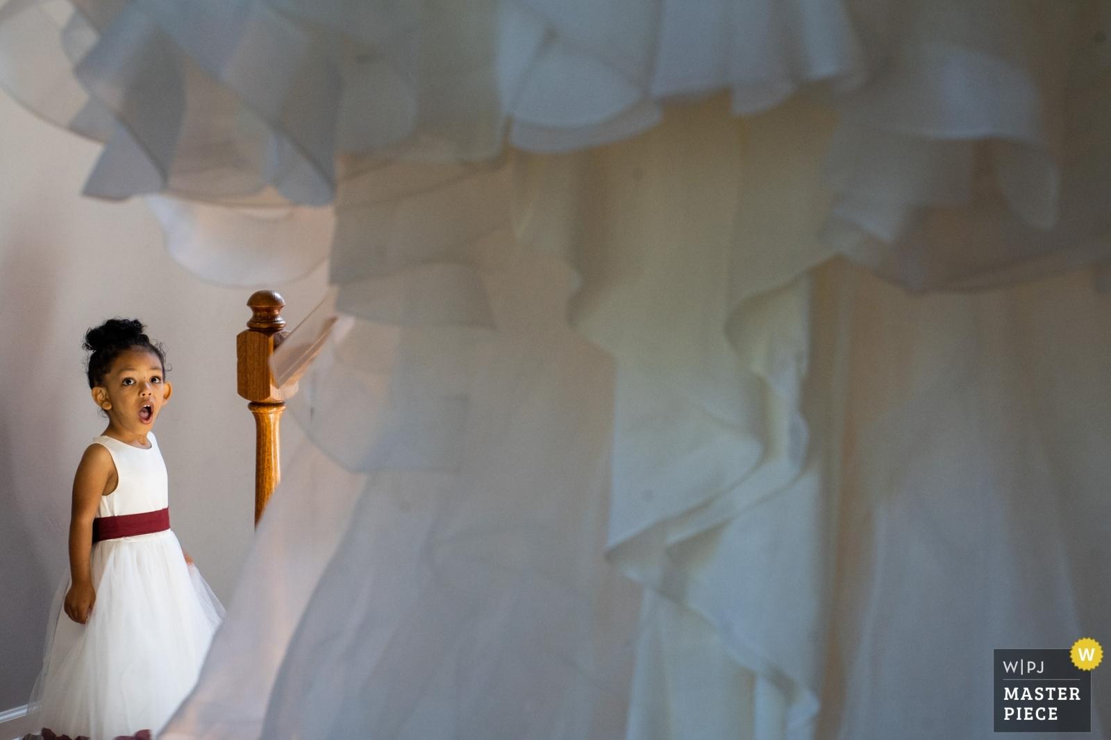 Flower girl loves the brides dress - Atlanta, Georgia Wedding Photography -  | Lawrenceville Georgia Home