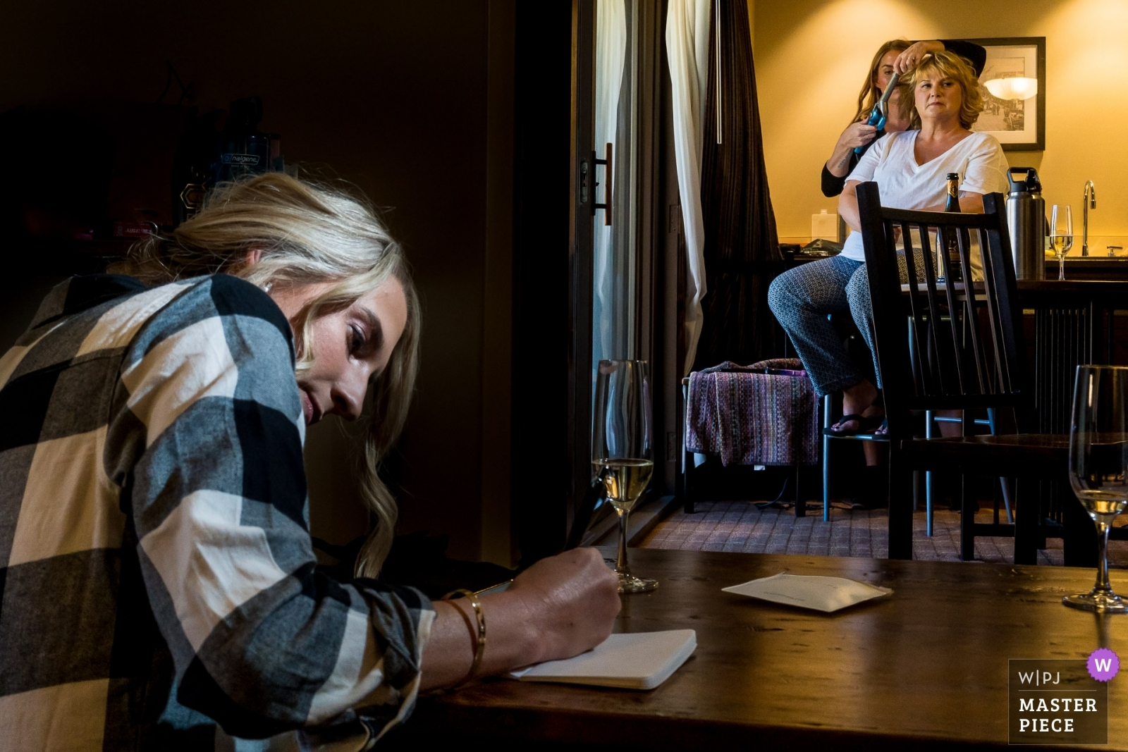 Bride finishing vows while mom gets hair done. - Denver, Colorado Wedding Photography -  | Telluride Peaks Resort