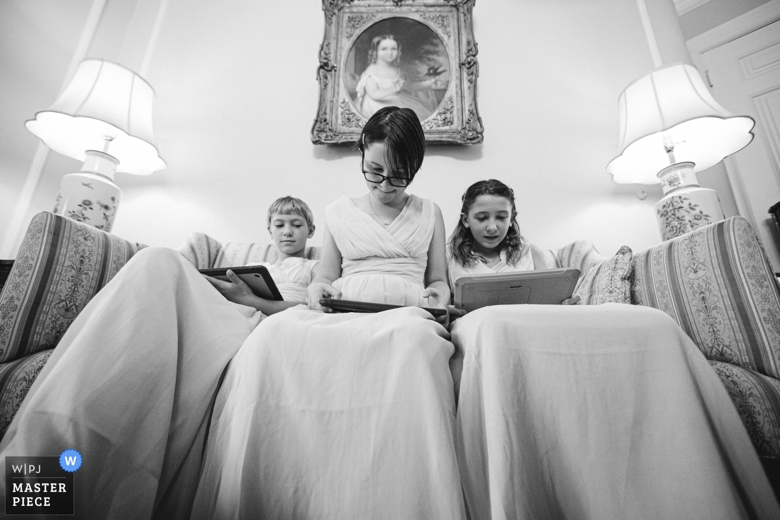The junior bridesmaids whiling their time, waiting for the ceremony to begin, while their mother helps the bride with final dress adjustments. - Virginia, United States Wedding Photography -  | Whittemore House, Washington DC