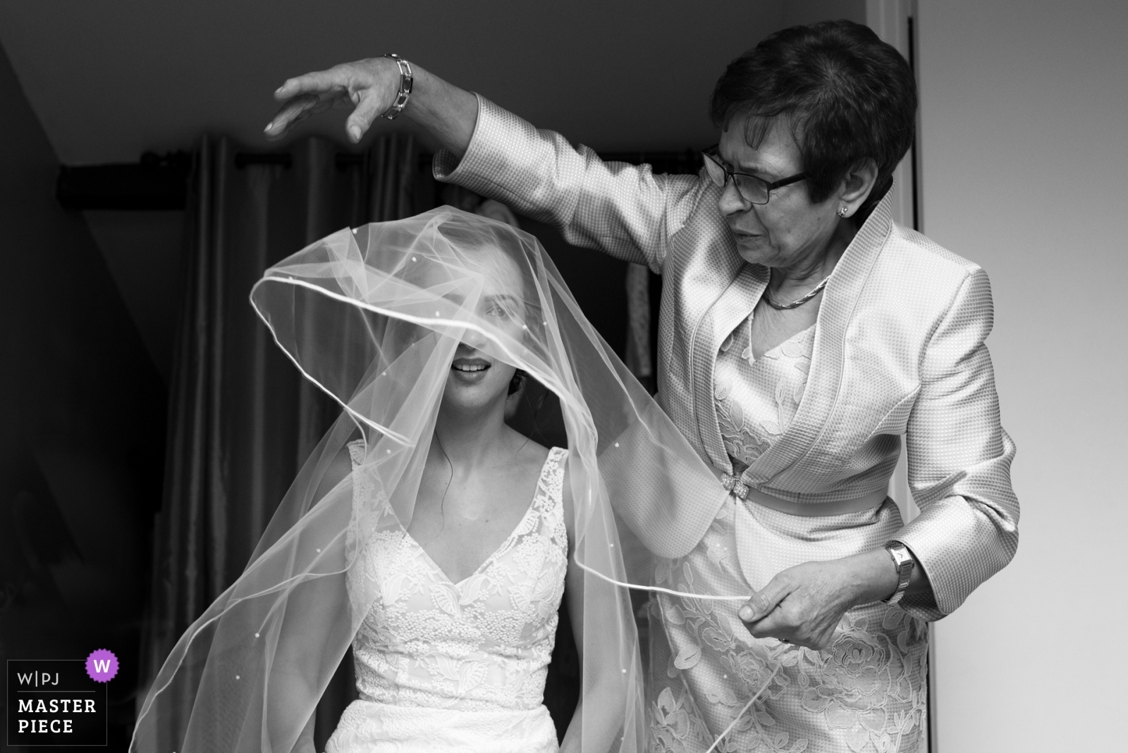 The mother of the bride is helping her with the veil - Nouvelle-Aquitaine, France Wedding Photography -  | Paris