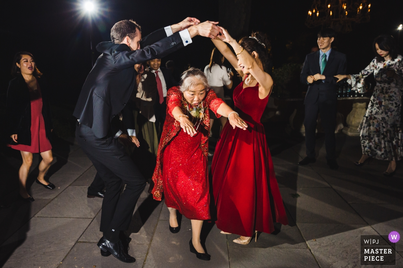All ages are enjoying the dancing party at the wedding.  - New York - Long Island, United States Wedding Photography -  | The North Shore House