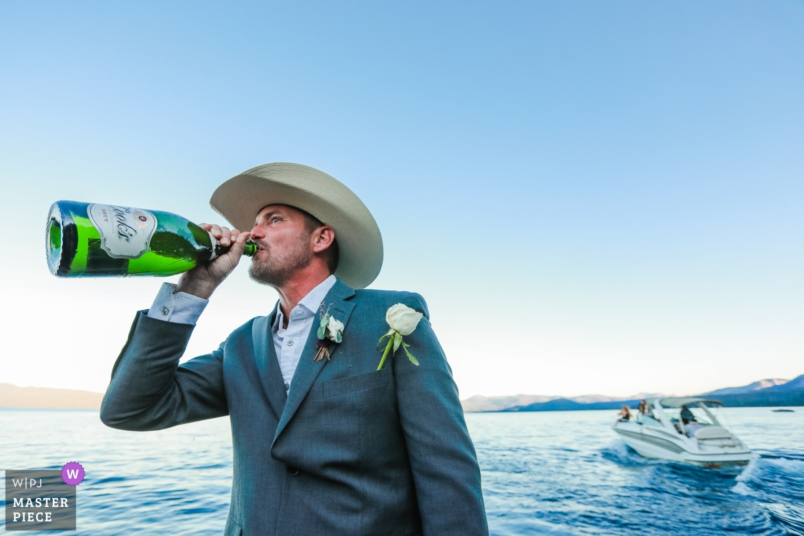 The groom enjoys just a small sip of champagne after his ceremony, held on a boat in the middle of Lake Tahoe.  - Lake Tahoe, California - Northern Wedding Photography -  | South Lake Tahoe, CA
