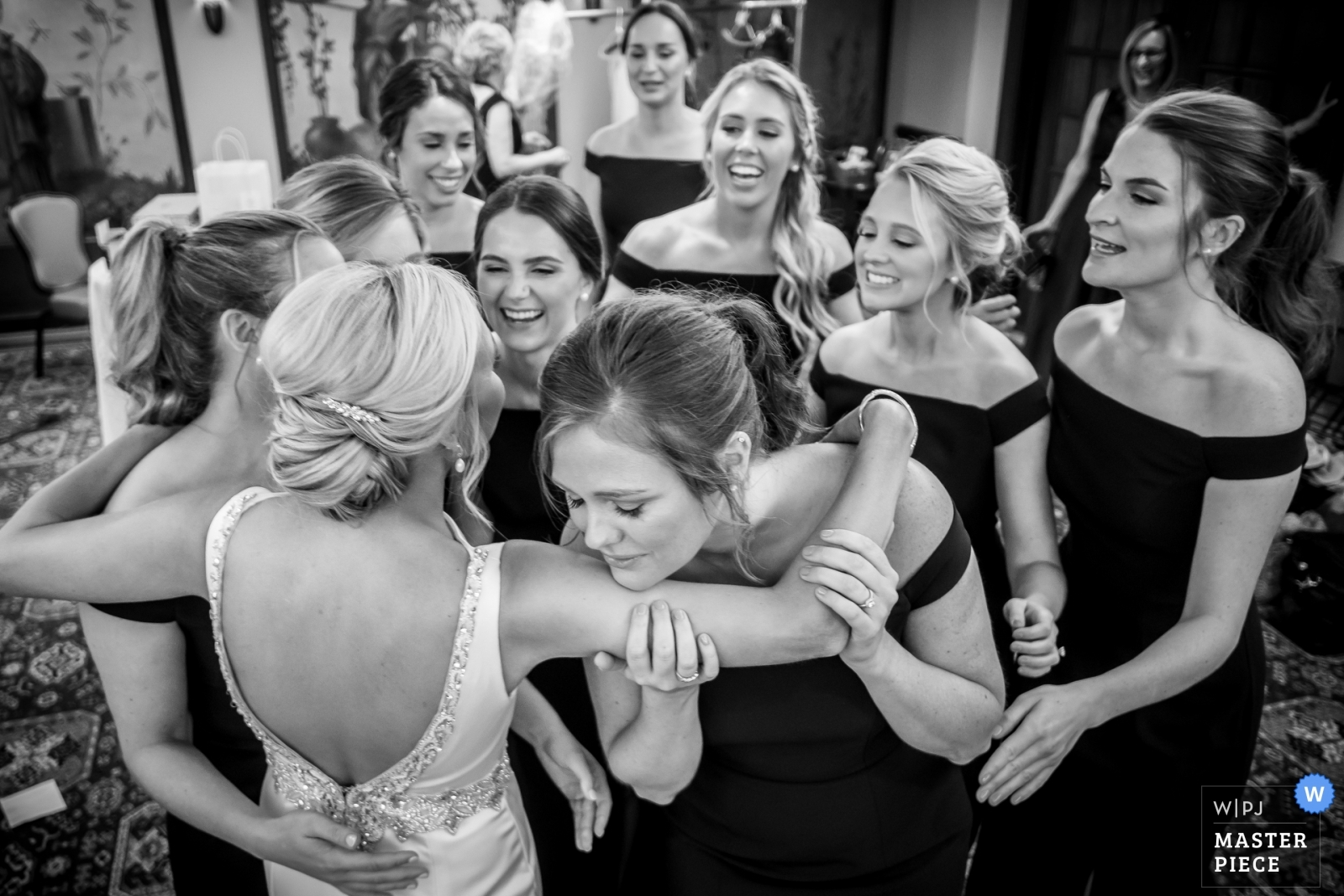 Bridesmaids see the bride in her dress for the first time. - Detroit, Michigan Wedding Photography -  | Detroit Athletic Club, Detroit, MI
