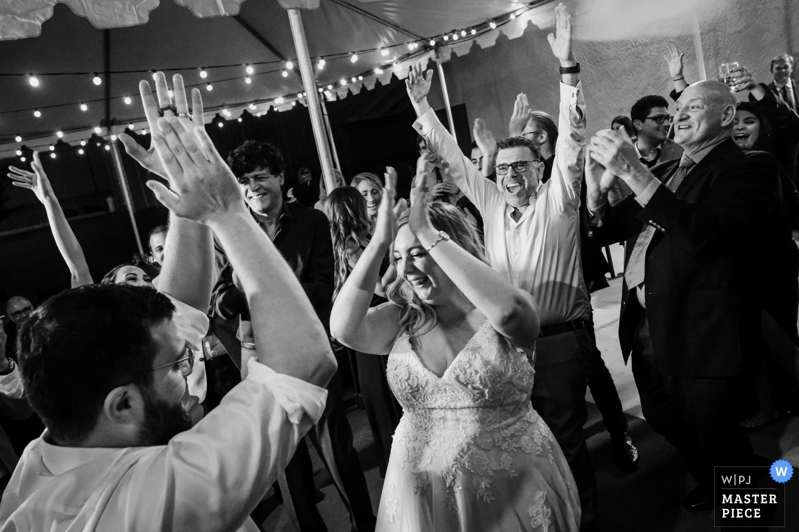Bride and groom dance during their Lebanese wedding traditions - San Diego, California - Southern Wedding Photography -  | Claremont, CA, Stokers car musuem
