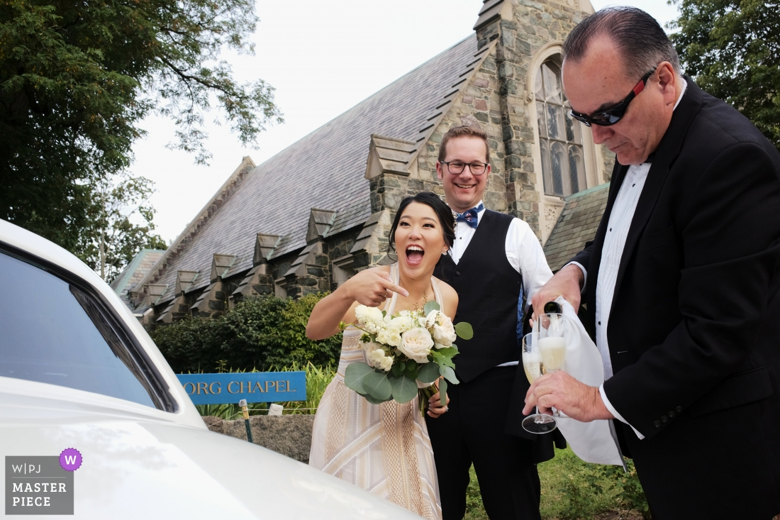 Bride and Groom being served champagne from limo driver - Boston, Massachusetts Wedding Photography -  | Swedenborg Chapel Cambridge, MA