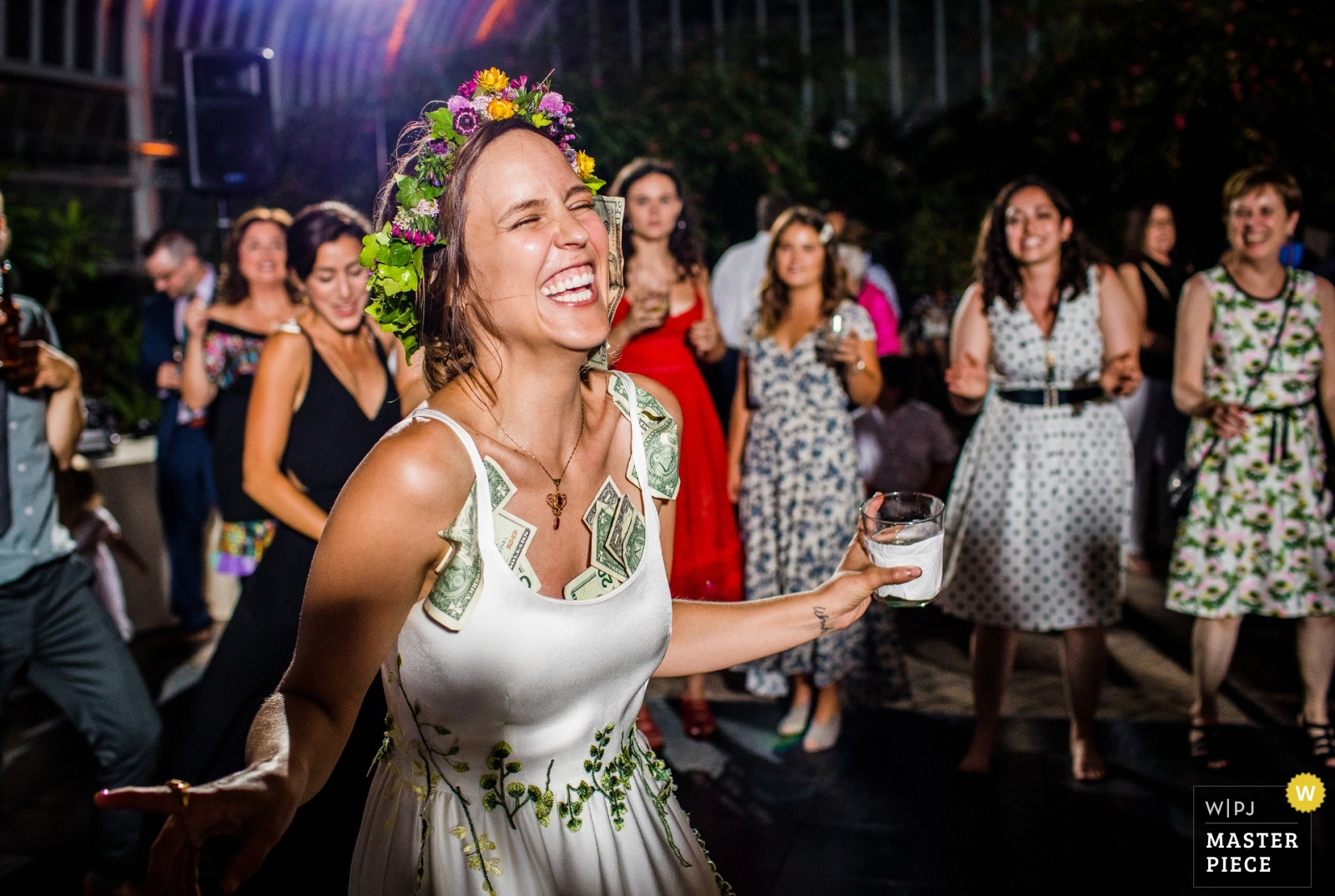A bride dances with a dress full of money during her wedding reception  - Chicago, Illinois Wedding Photography -    Reception Venue - Garfield Park Conservatory