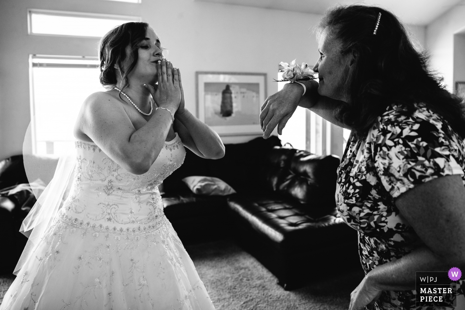 A bride and her mother goof off before the ceremony. - Lake Tahoe, California - Northern Wedding Photography -  | South Lake Tahoe, Private Home