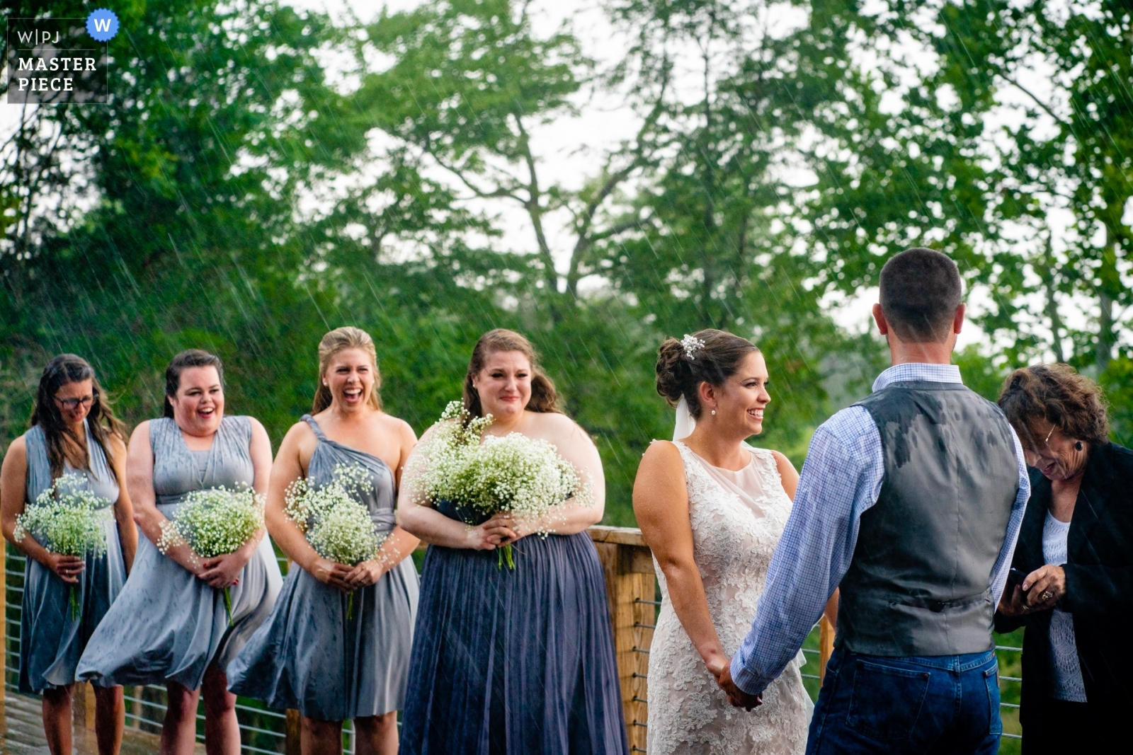 Bridesmaids are surprised by the wind and rain during the wedding ceremony - Arlington, Virginia Wedding Photography -  | Rixey Manor, Rixeyville, VA, USA