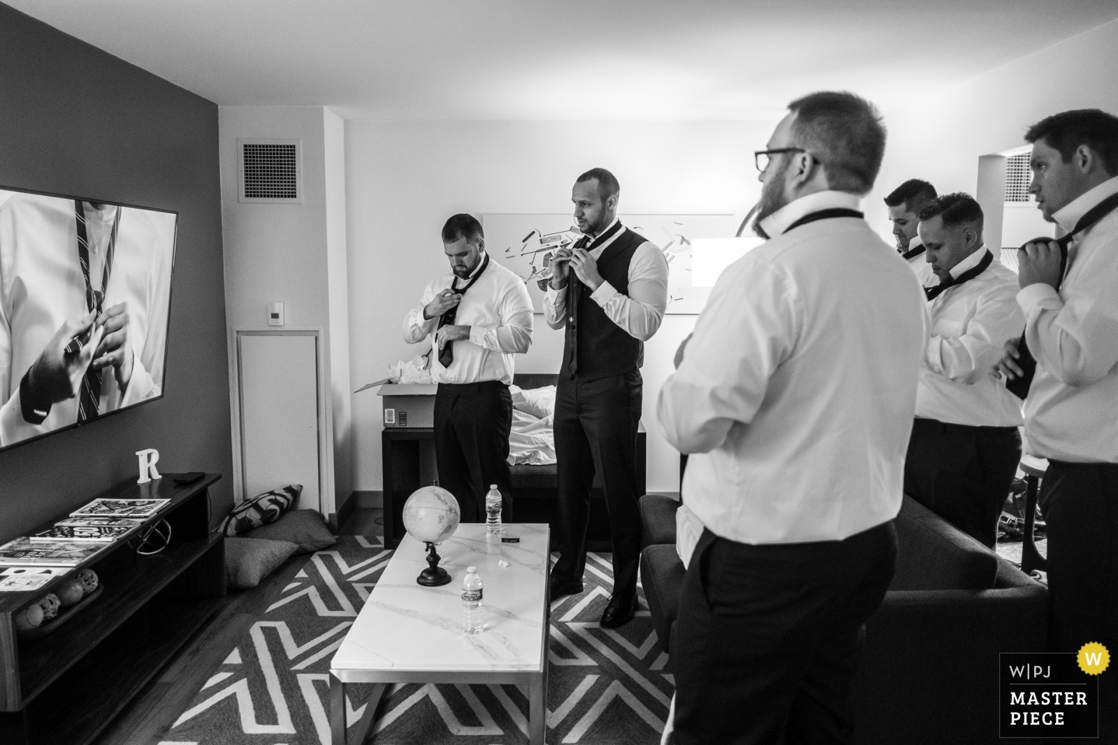 Groomsmen need video to help them make a double Windsor knot. (angle 2) - Detroit, Michigan Wedding Photography -  | The Baronette Renaissance Detroit-Novi Hotel