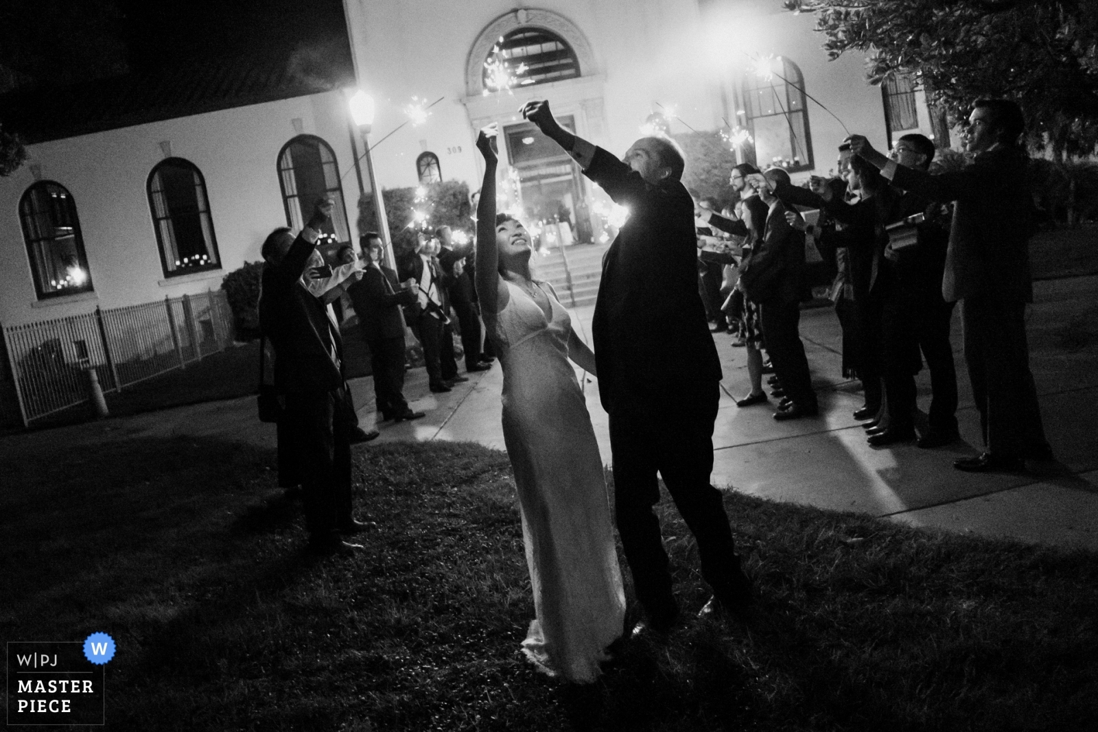 The bride and groom play with their sparklers at the end of their wedding night. - Los Angeles, California - Southern Wedding Photography -  | Redondo Beach Historic Library