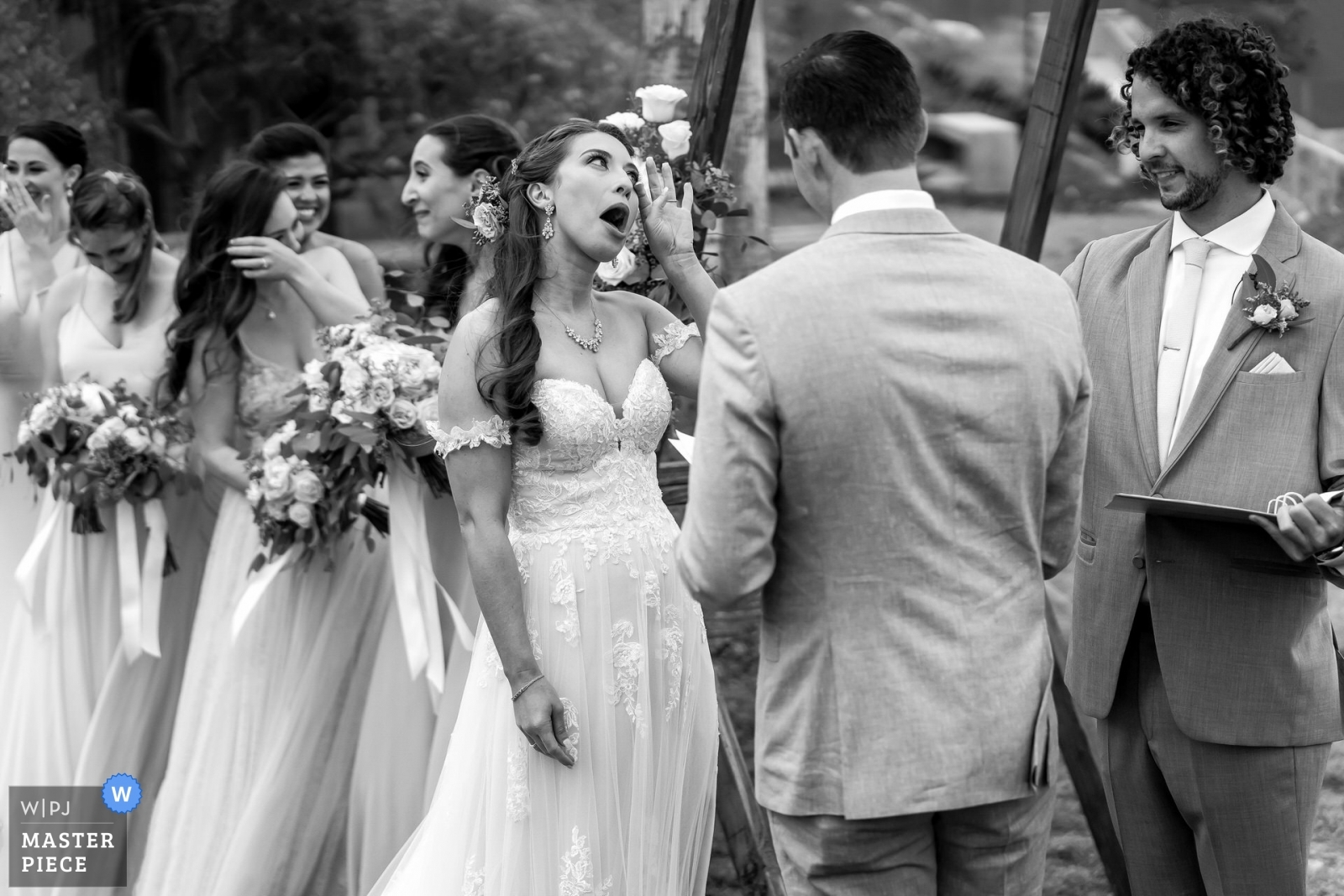 A funny moment during the wedding ceremony.  - San Diego, California - Southern Wedding Photography -  | Scripps Seaside Forum, La Jolla, California.