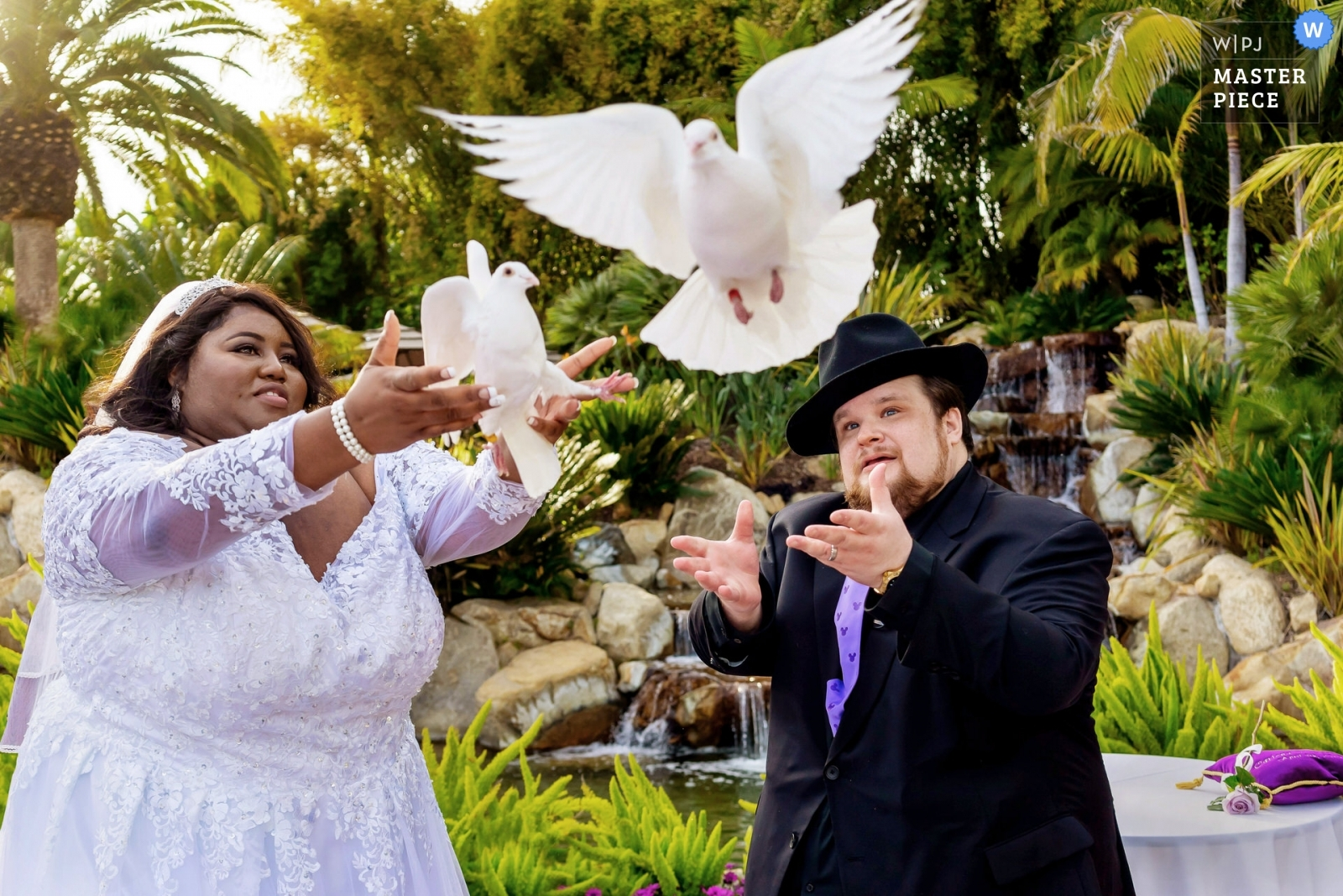 The bride and groom release doves during their wedding ceremony.  - San Diego, California - Southern Wedding Photography -  | Grand Tradition Estate and Gardens, Fallbrook, CA