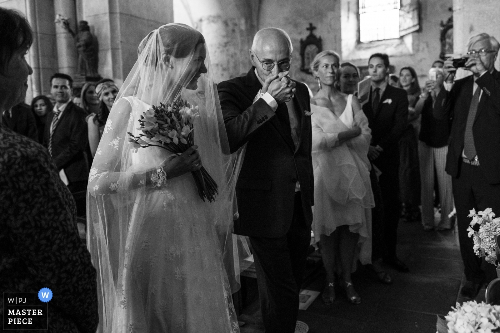 Father kisses his daughter in the church - Nouvelle-Aquitaine, France Wedding Photography -  | Ambazac