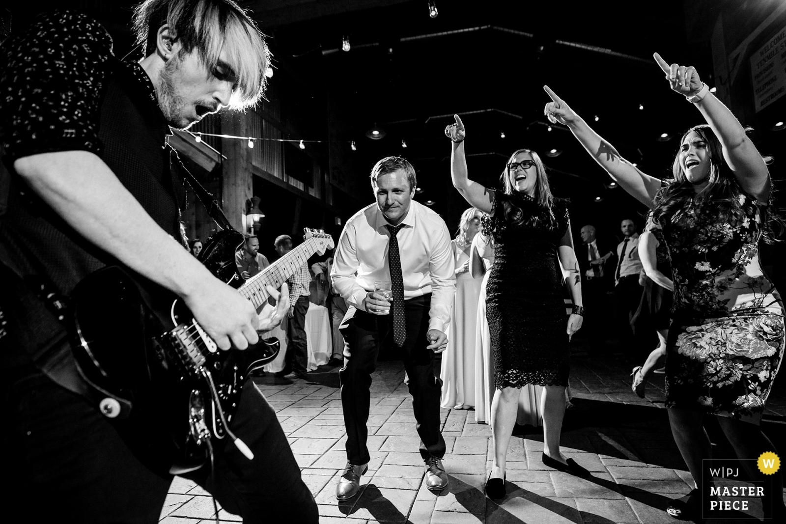 The wedding guests getting down to the live band during the reception. - Colorado, United States Wedding Photography -  | Tenmile Station, Breckenridge, CO