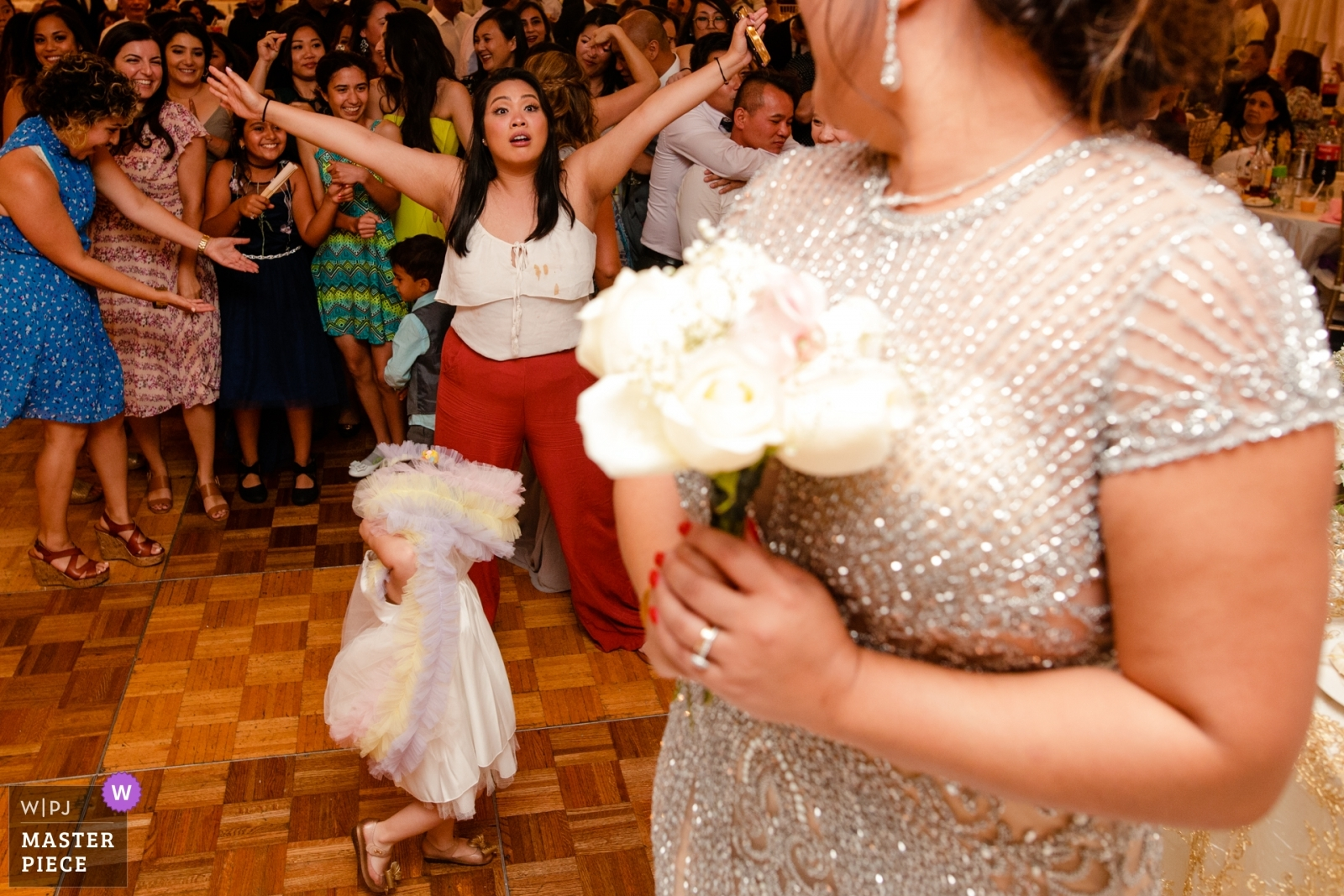 The little girl walked over before the bride threw the bouquet - San Jose, California - Northern Wedding Photography -  | Dynasty Restaurant