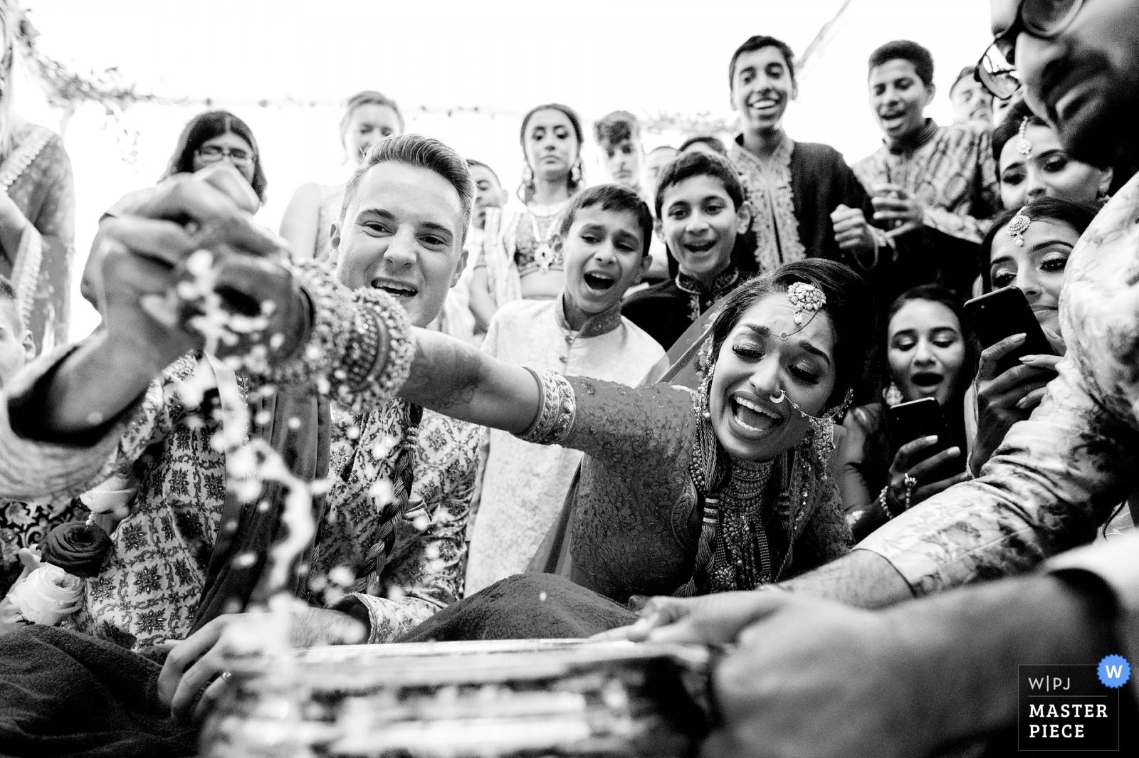 Hindu wedding game of ring fishing  - West Midlands, England Wedding Photography -  | Froyle Park wedding venue, UK