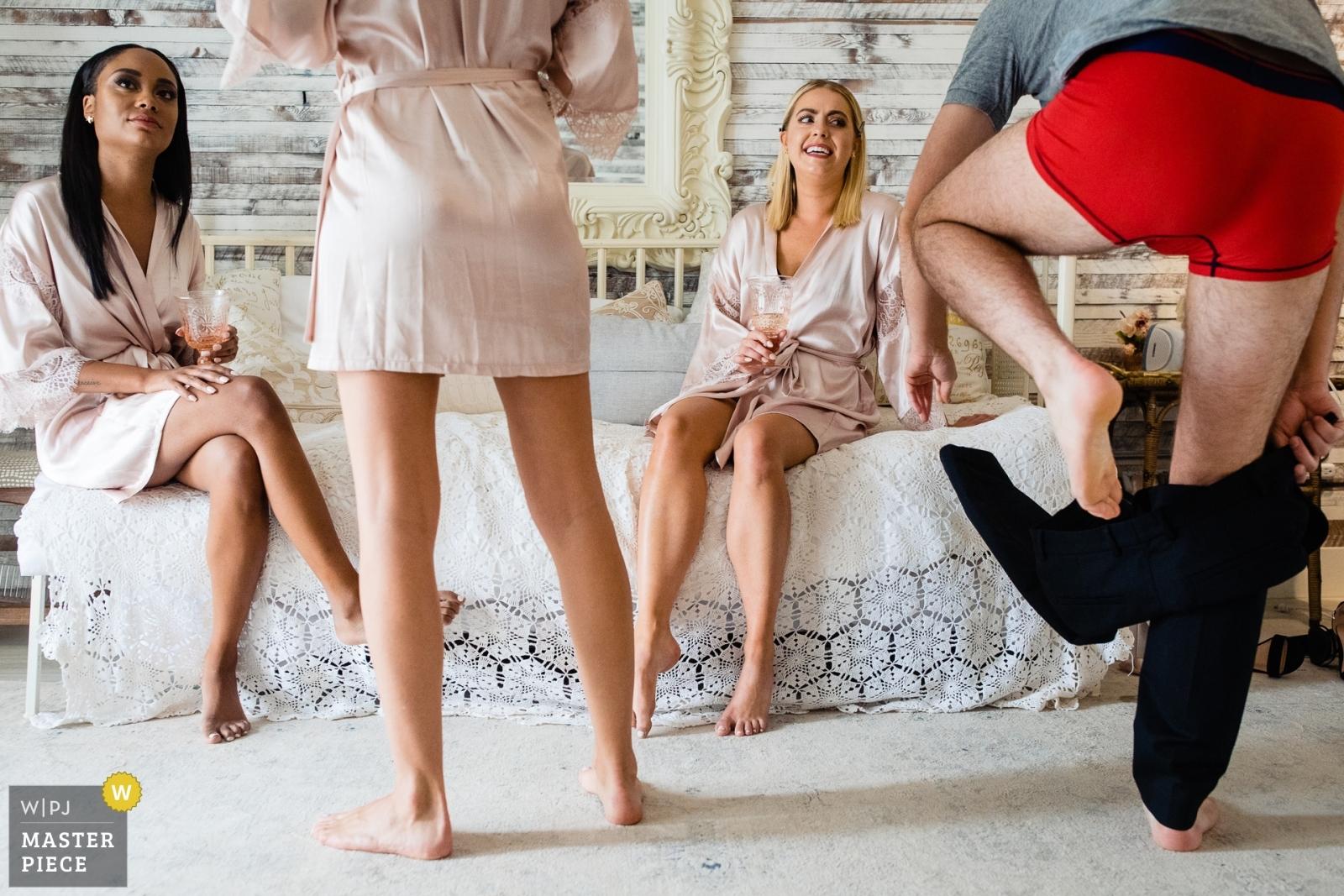 Bridesman gets a weird look while getting dressed - Missoula, Montana Wedding Photography -  | Belgrade, Montana