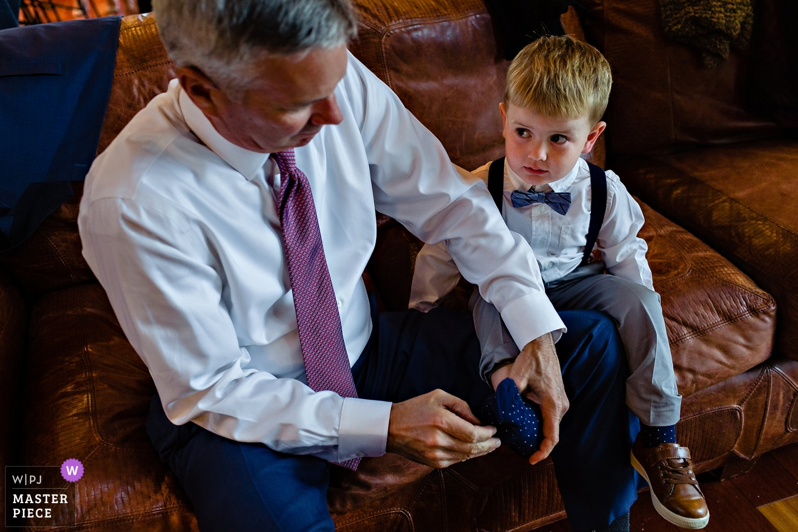 The bride's son gets dressed with his grandfather at the Maine wedding ceremony - New Hampshire, United States Wedding Photography -  | Bald Mountain Camps Rangeley Maine