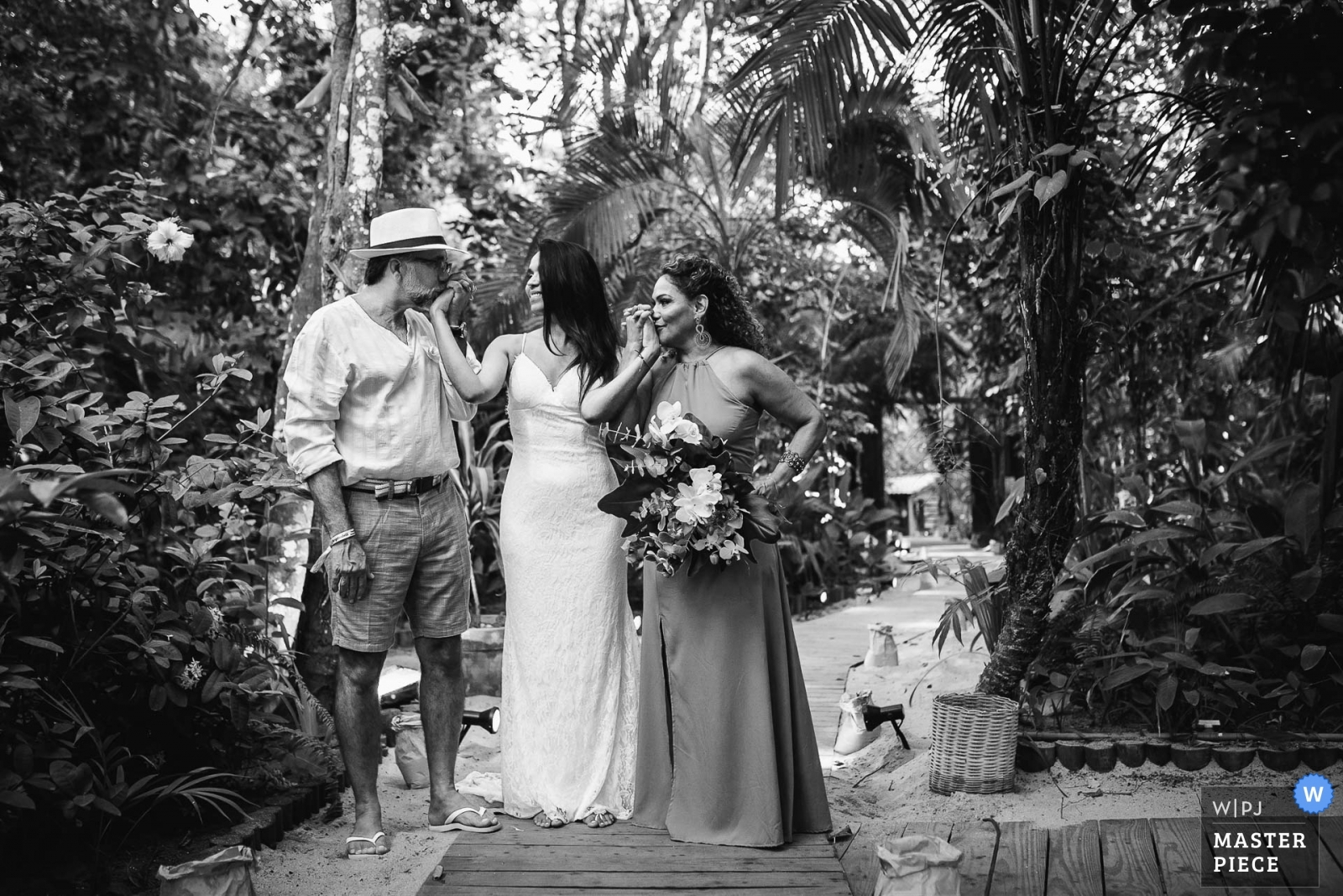 A minute before the bride enters the ceremony, she has her hands kissed by her parents. - Rio de Janeiro, Brazil Wedding Photography -  | Pousada Bahia Bonita - Trancoso - Bahia - Brazil