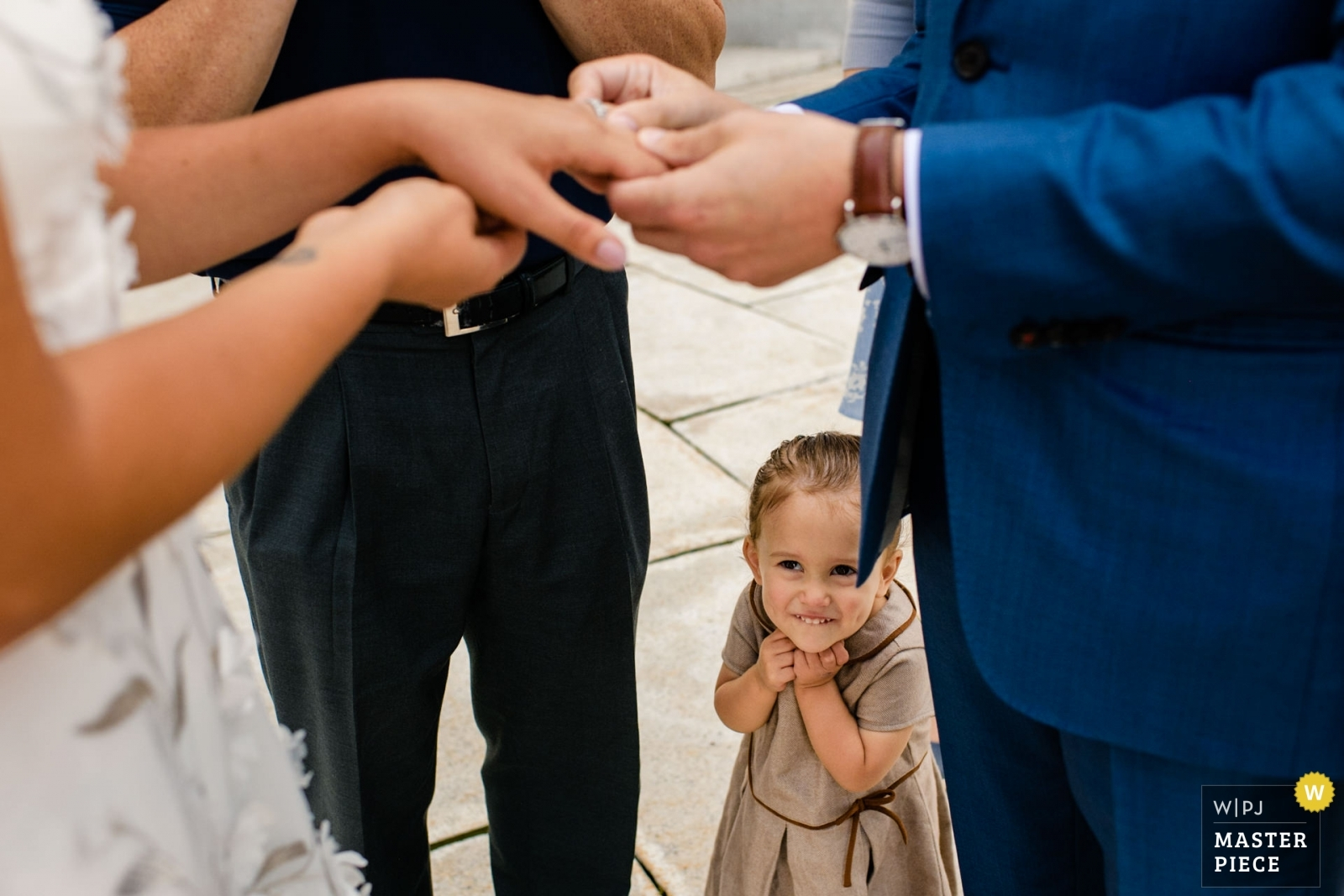 Groom's niece smiles as the bride and groom exchange rings - Madison, Wisconsin Wedding Photography -  | Wisconsin State Capitol